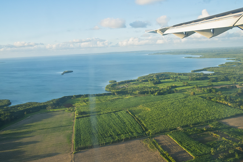 Airplane landing in Guadeloupe French Caribbean. Surf, hiking, yoga, fresh coffee and endless send beaches are waiting!