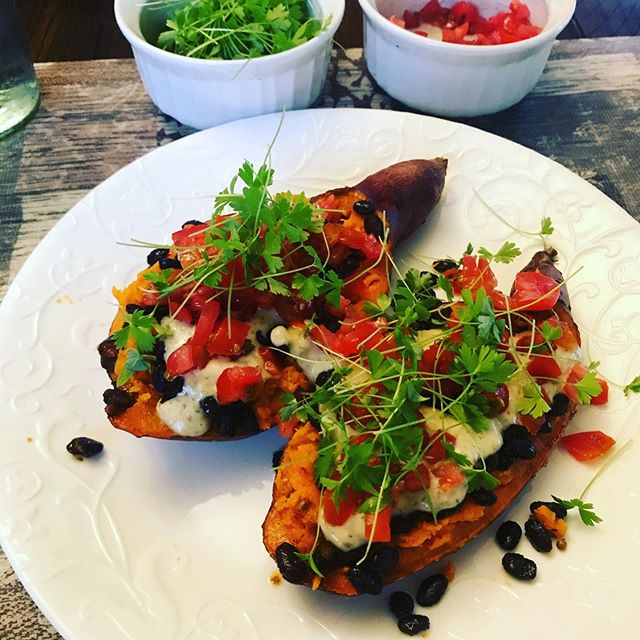 Baked sweet potato #seasoned #blackbeans #cinnamon #coriander #oliveoil #cumin #paprika  #sweetpotato #parsleymicrogreen #tomatoes #garlicdillsauce #lemonjuice #hummus #cookathome #instantpot #growgreens #growtubers #vegetablegardening