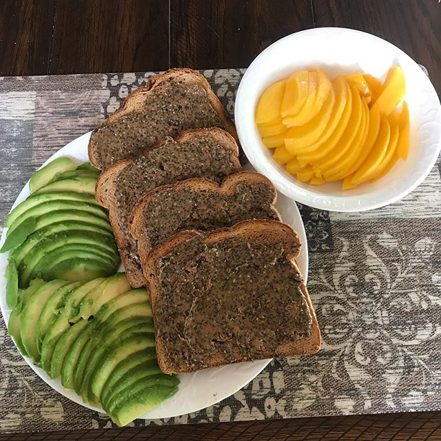 My favorite lunch for summer.  Two sliced avocados with a pinch of salt, one sliced mango, and whole wheat toast with almond butter, topped with chia seeds.  To a jar of nut butter, I add leaf powder and kelp powder. Wash it down with lemon and mint water.  #avocado #mango #wholewheattoast #almondbutter #chiaseeds #kelppowder #leafpowder #lemonmintwater #vegan #plantbased #fruit #lunchtime