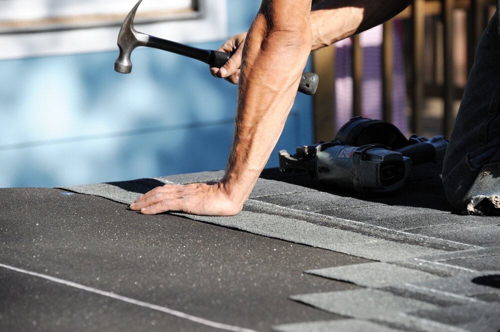 When should I consider replacing my entire roof in Los Angeles?