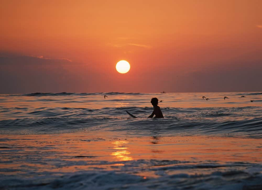 Surfing at sunset Costa Rica