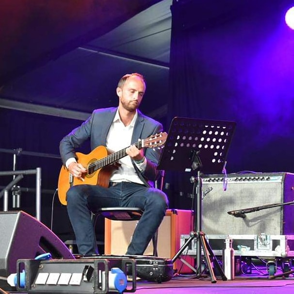 Performing on the main stage at Cambridge Folk Festival with Melissa James. Photo by Aaron Parsons.