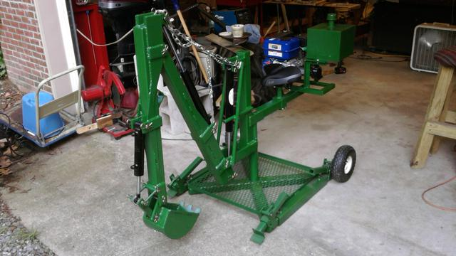 John's Backhoe - John built a machine that could probably be considered art work as well as a digging machine. I think I would build a second MACHINE to dig with and leave this one to look at.That gel seat looks really comfy.Beautiful job!