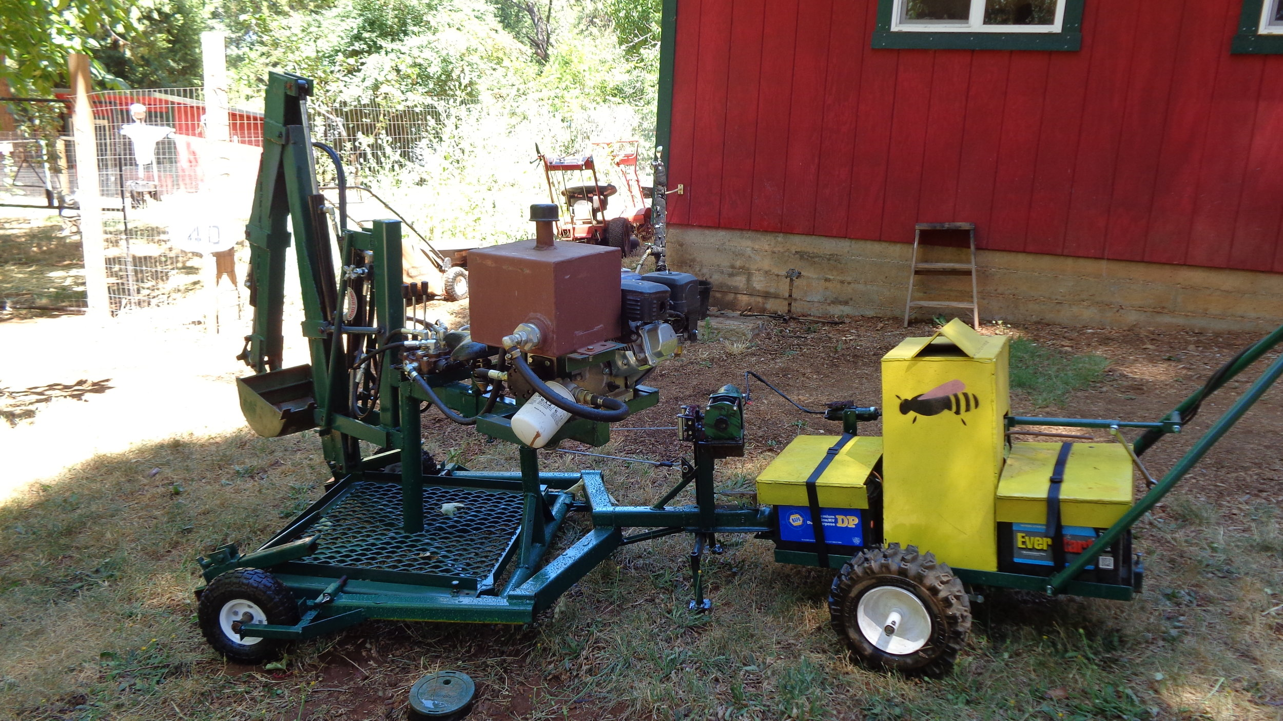 Backhoe next to shop with Worker Bee 1.JPG