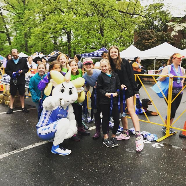 Handing out medals and cheering on runners at the #tarheel10miler this morning! The rain didn't dampen our spirits! #skipsations #20thanniversary #havefun