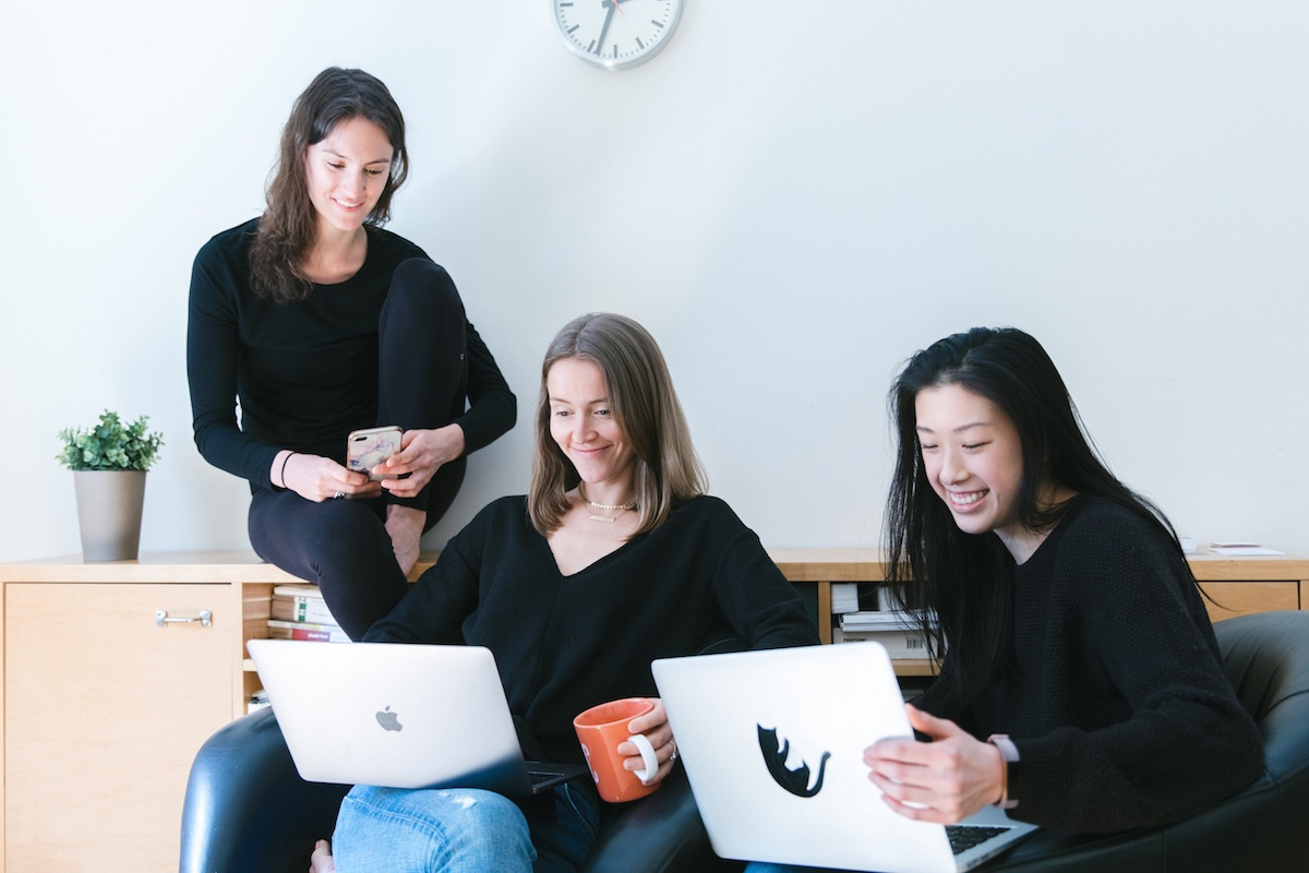 The Silver Linings Group Home Page Image- Danielle Radulski, Maggie Hayes, Gillian Shieh sitting in office setting