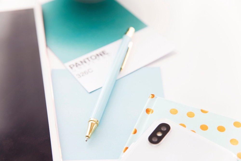 Graphic Design for Small Businesses - Pantone color with pen on a desk