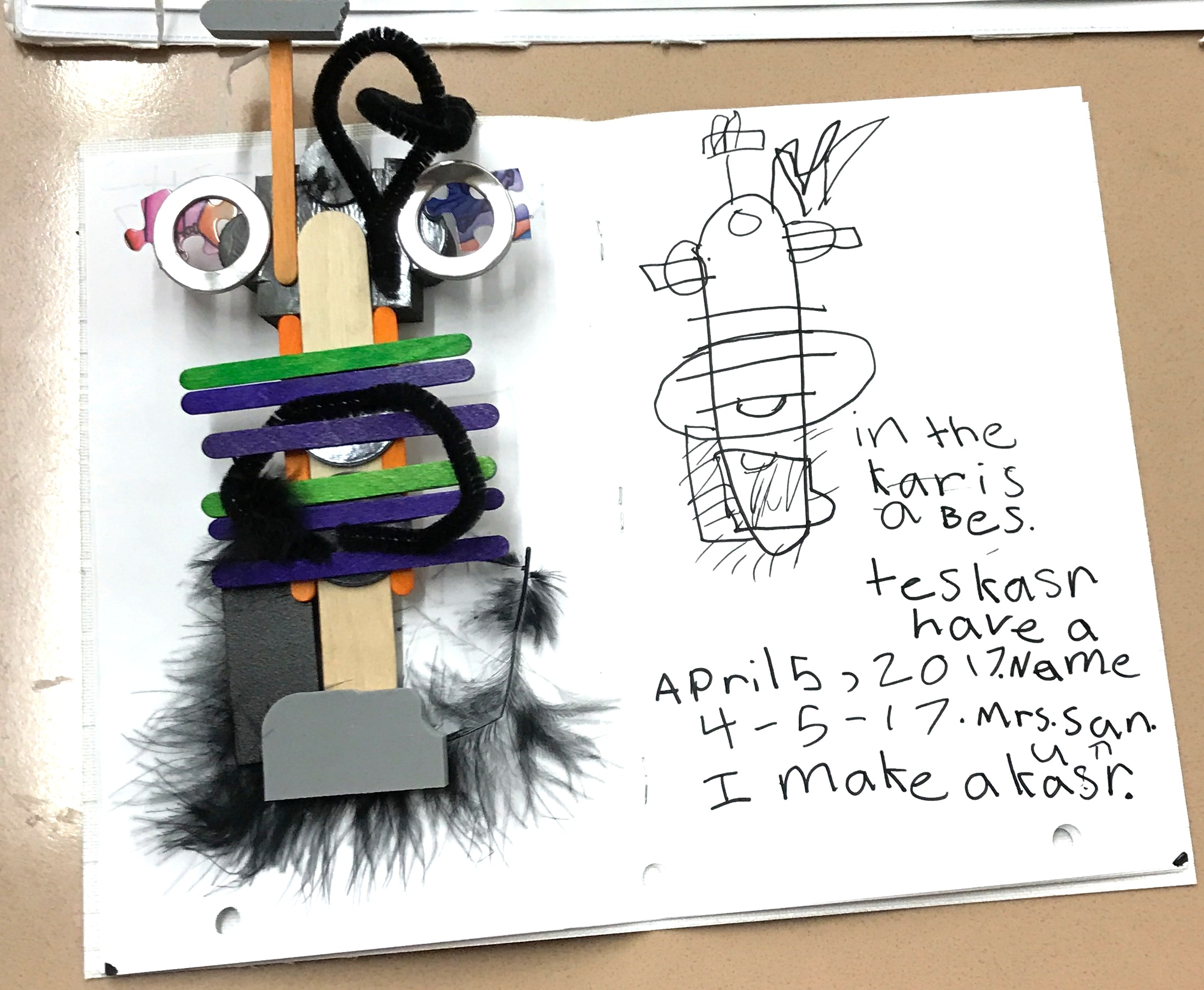 A young student deepens his learning by drawing his creation in a journal
