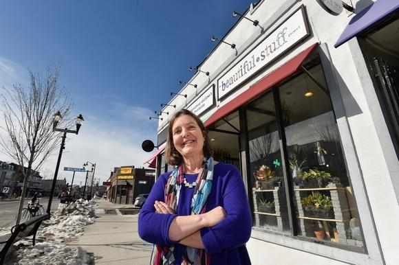 Founder, Marina Seevak, outside the original storefront in Somerville, MA