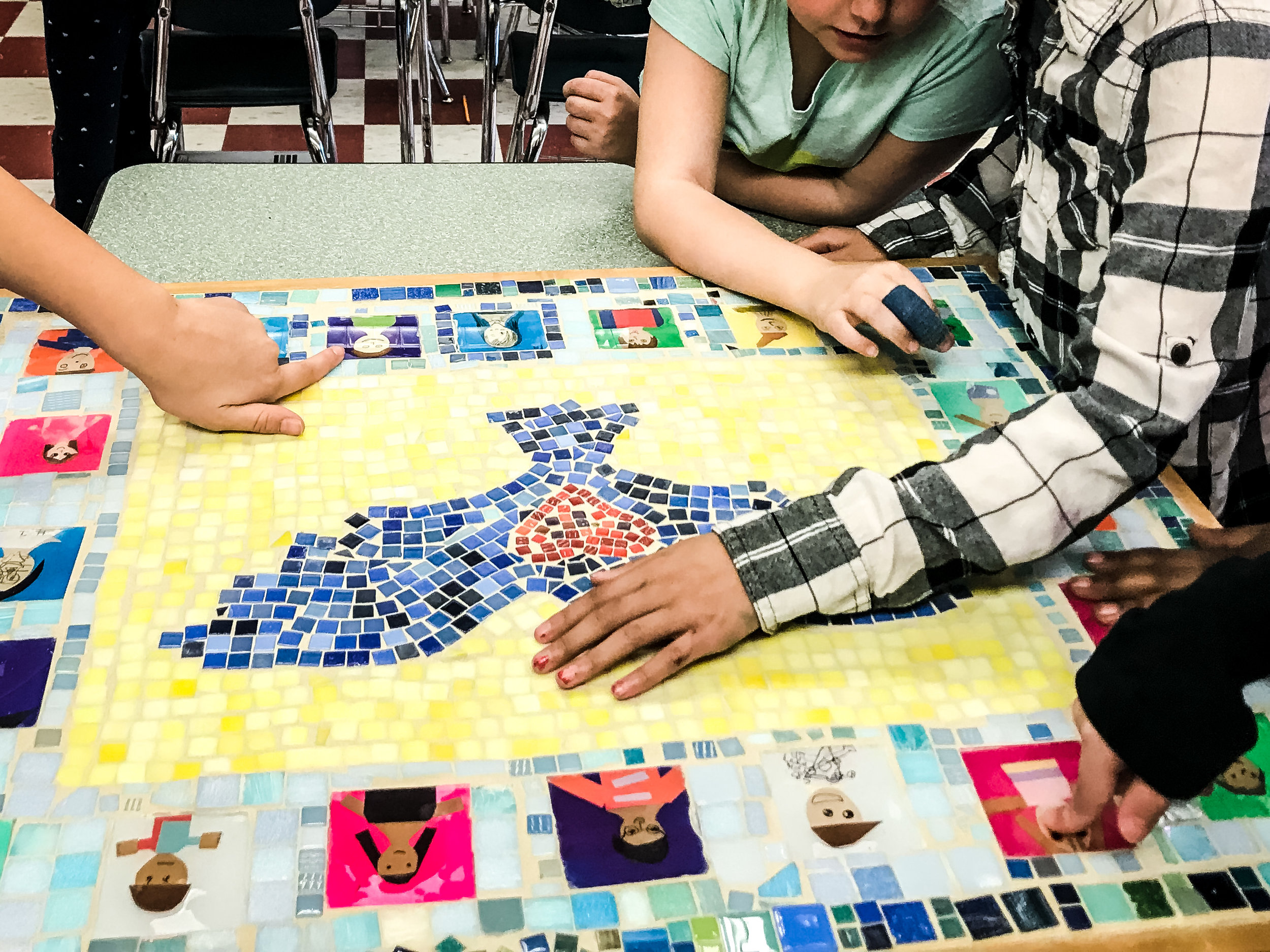 Students marvel at their finished mosaic project