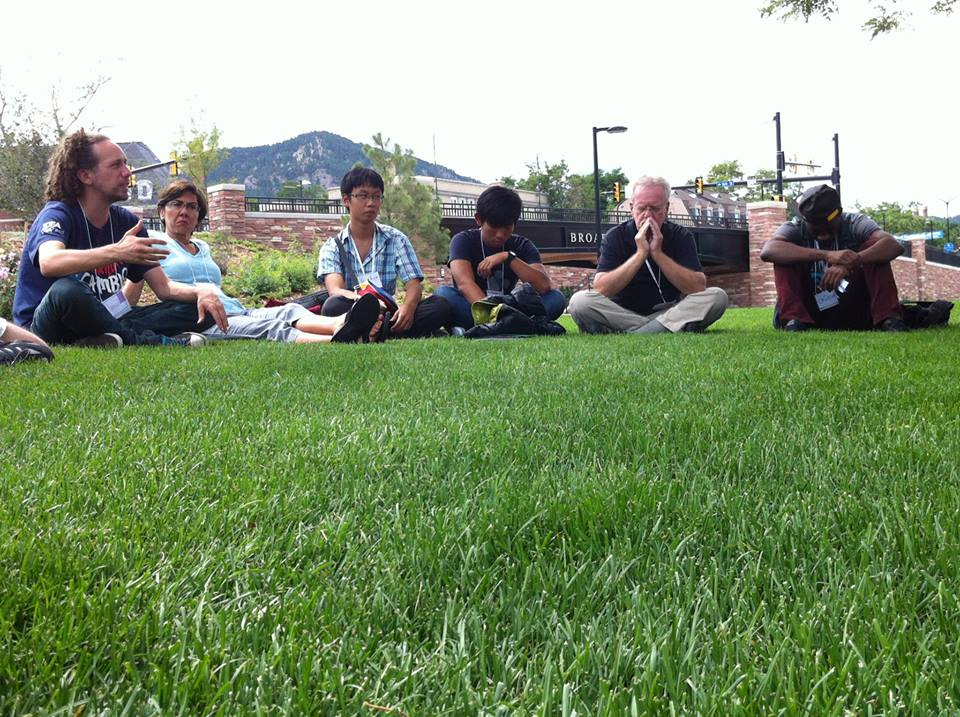 Jonah facilitating adults in the grass (IDEC CO).jpg