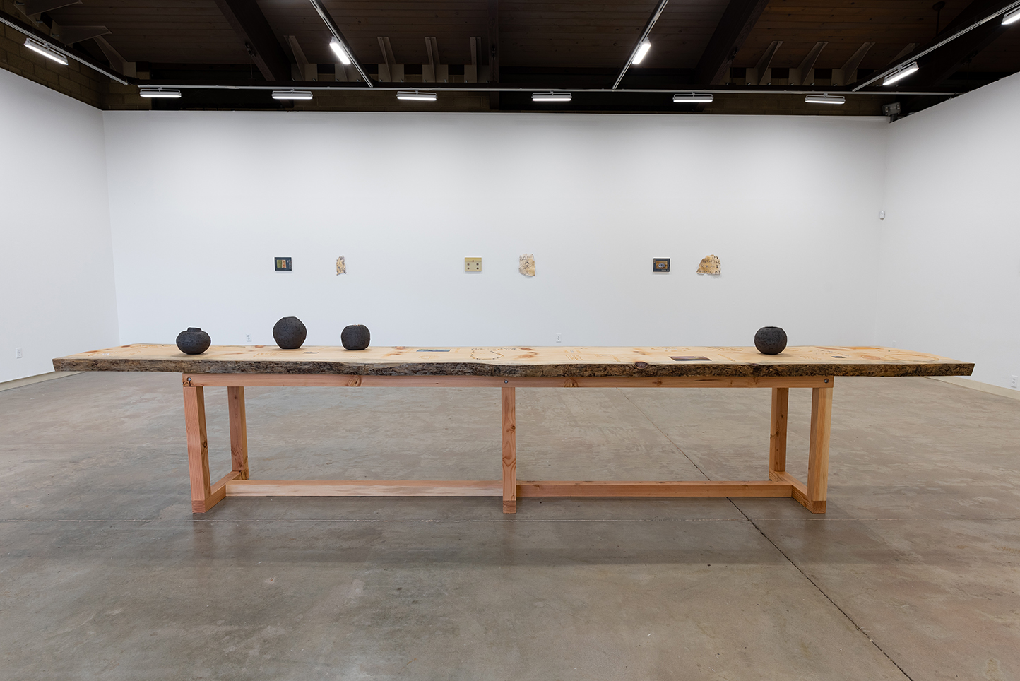 Communal Table  2018 Pine, ceramic, creek water, tile, granite, mica, obsidian, Aspen leaves, oil paintings, river clam shells, sage brush, serpentine, tin, tufa, sheep wool, wax 198 x 30 x 42 inches