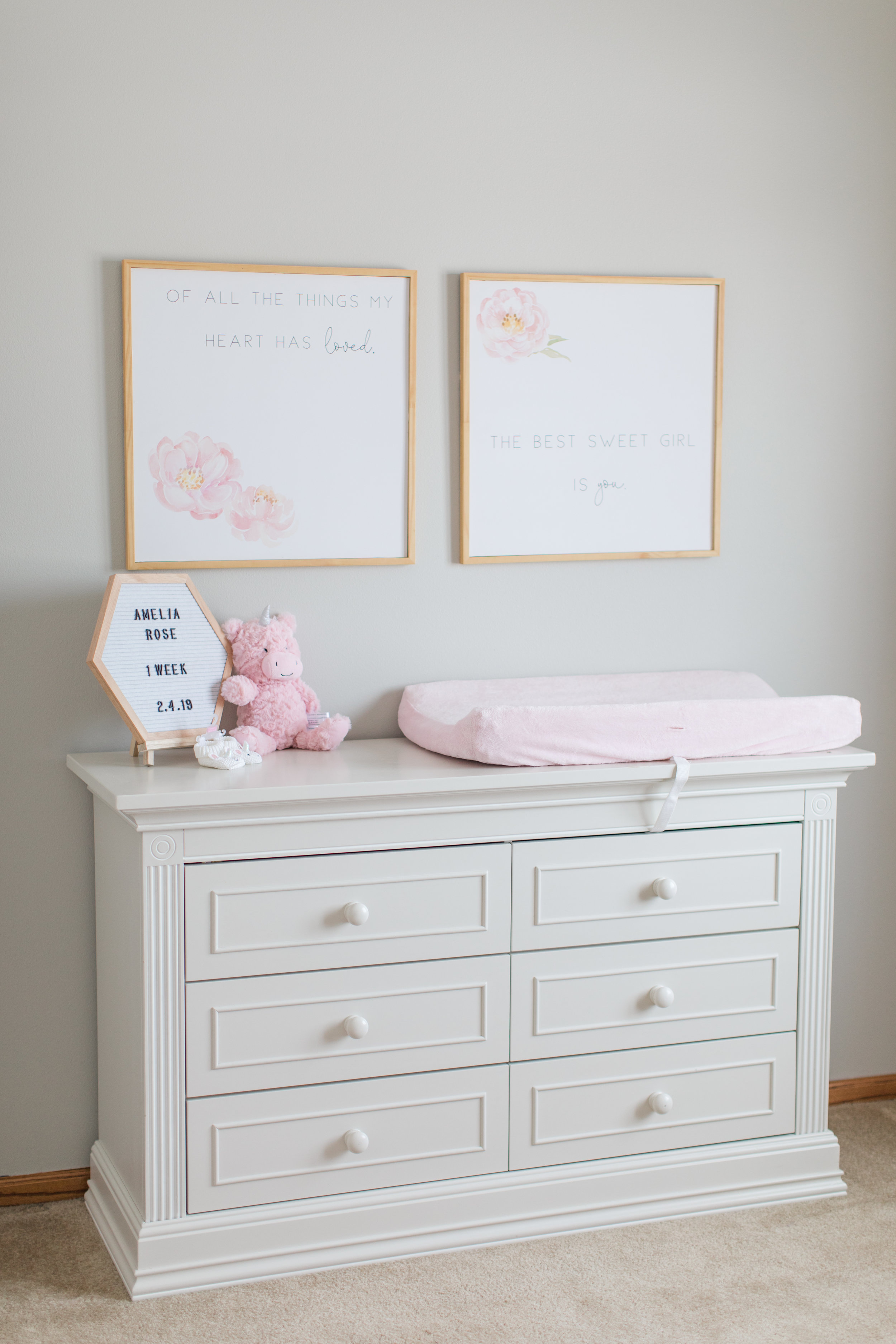 White Dresser In Baby Girl Nursery