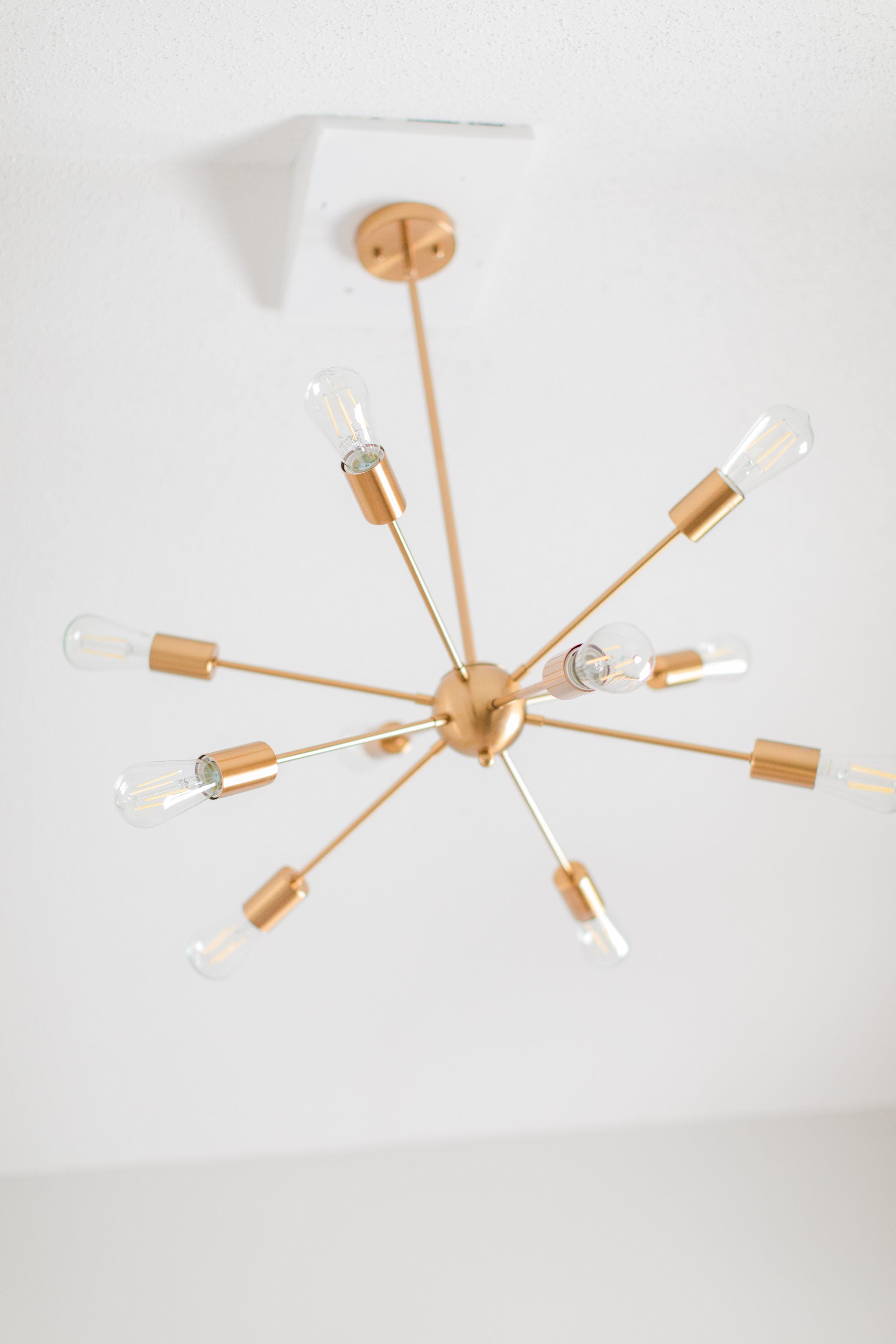 Modern Gold Chandelier In A Nursery