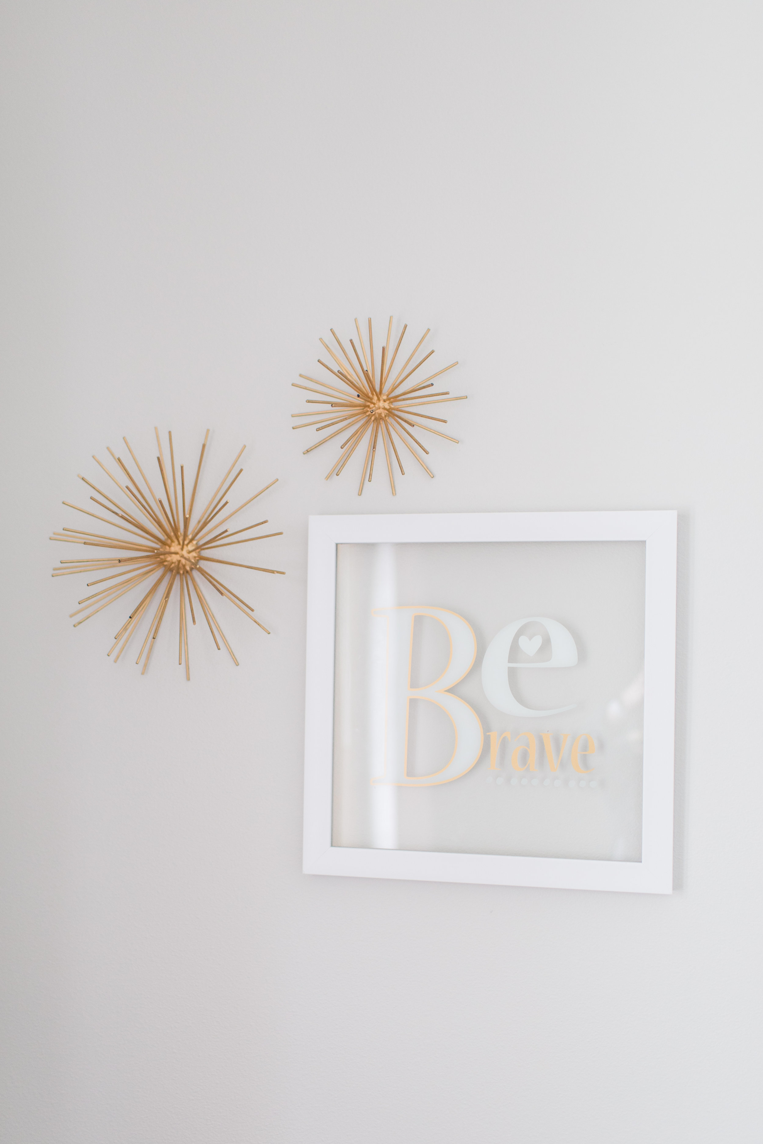 Gold and White wall decor in a girls nursery