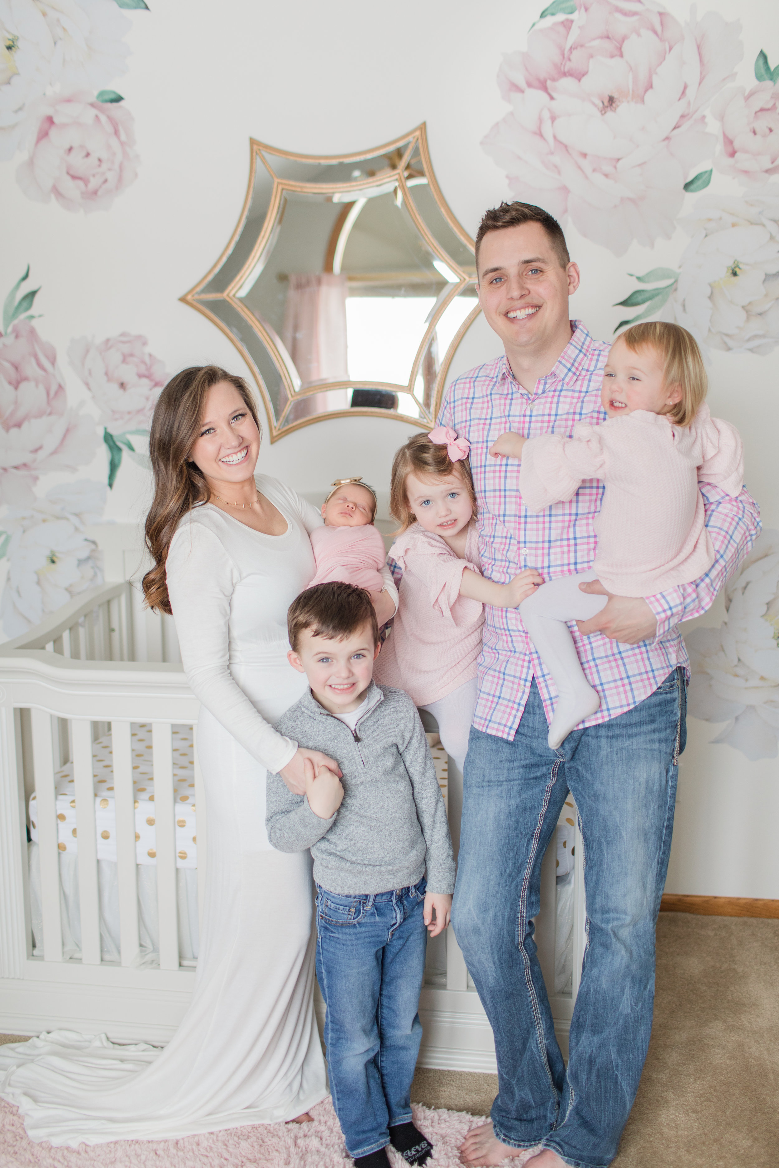 whole family picture with newborn baby girl
