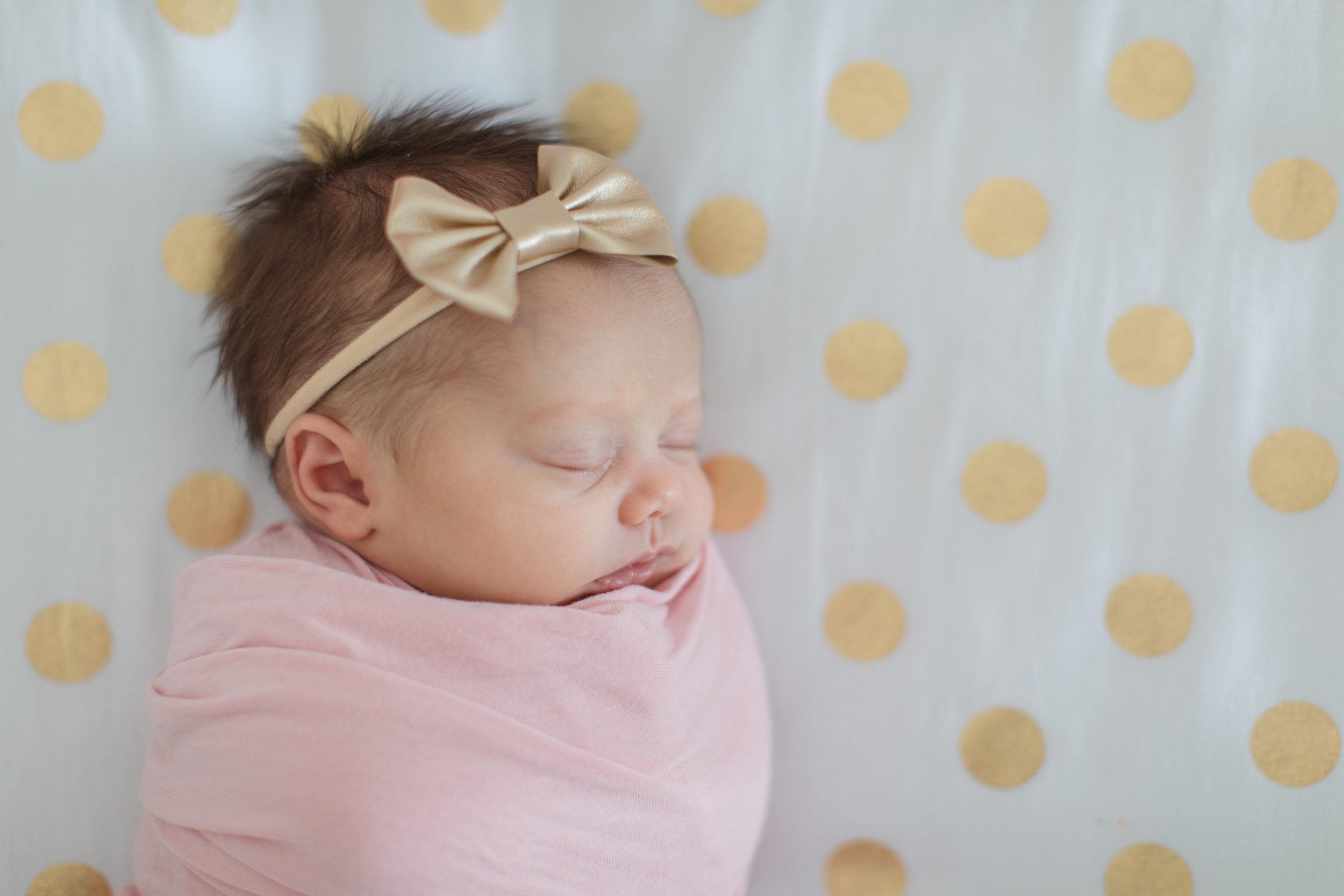 Newborn Girl in Crib