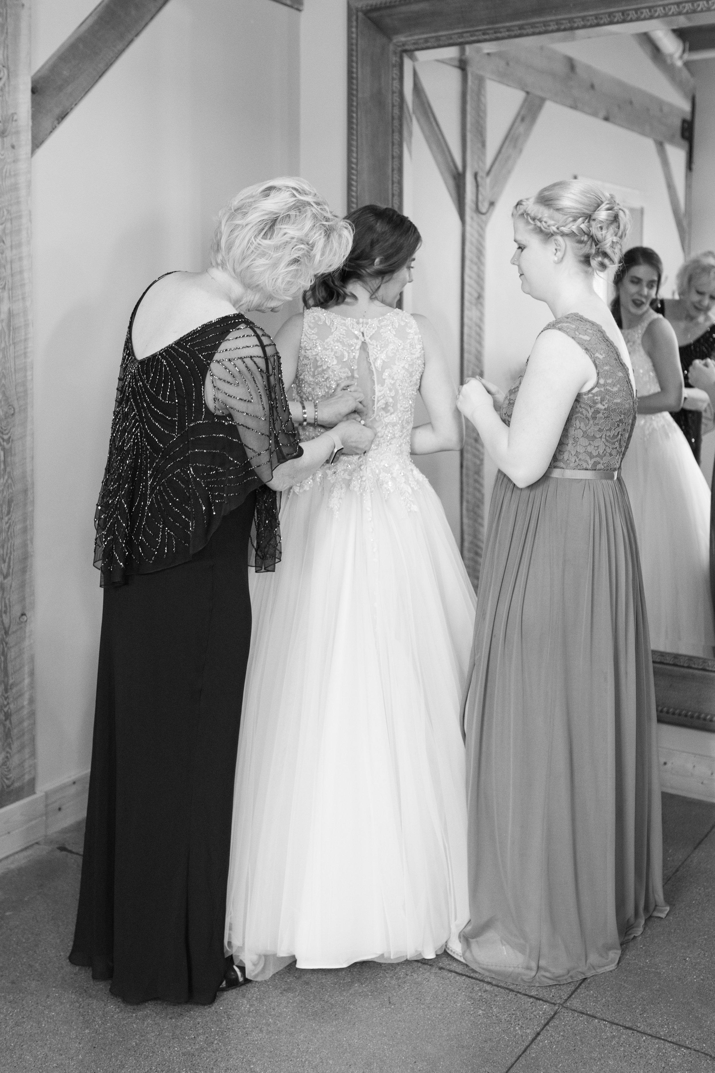 BrideGettingIntoHerWeddingDress