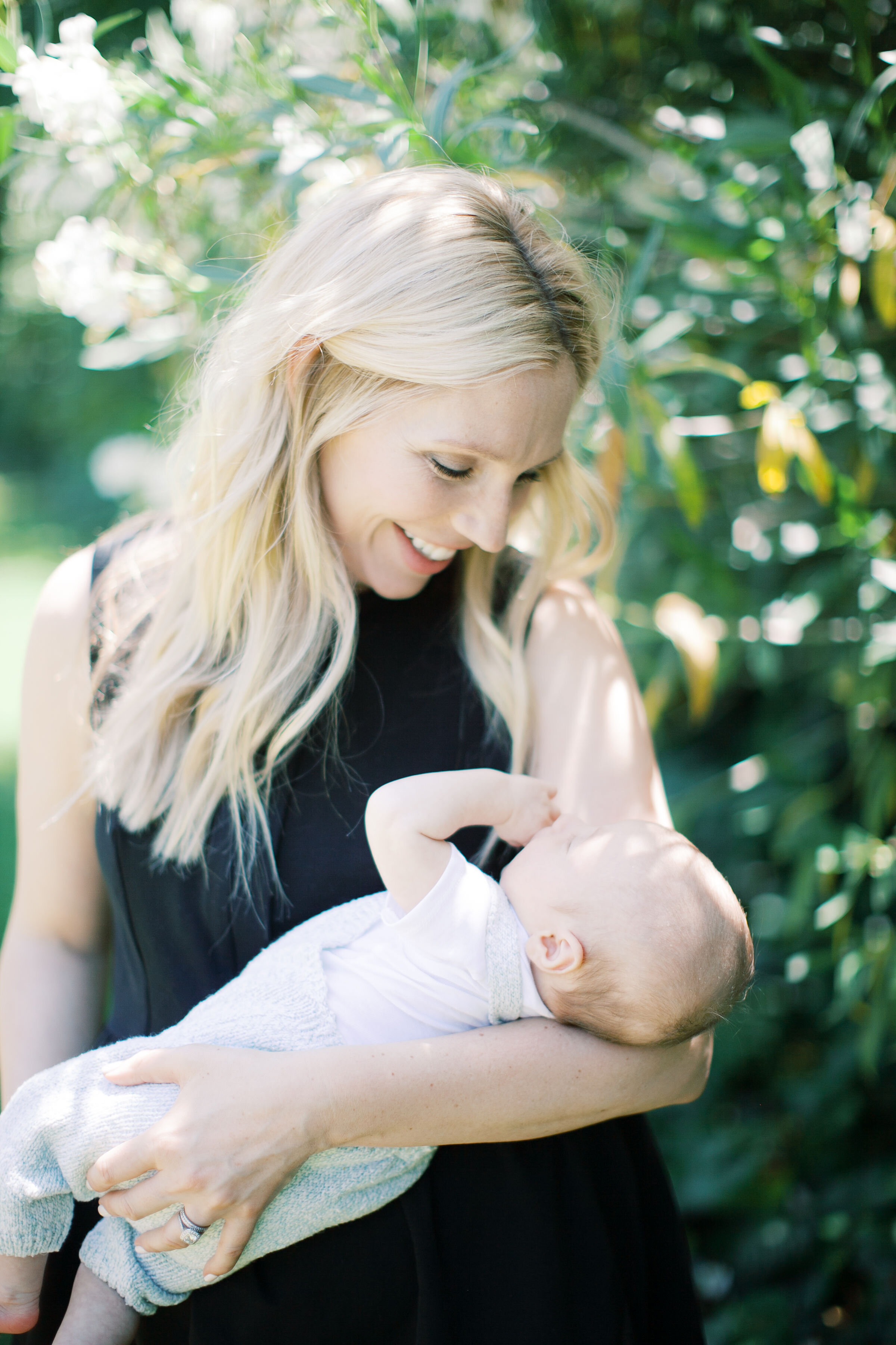 CEO and Founder, Devon Berrier holding her little one.