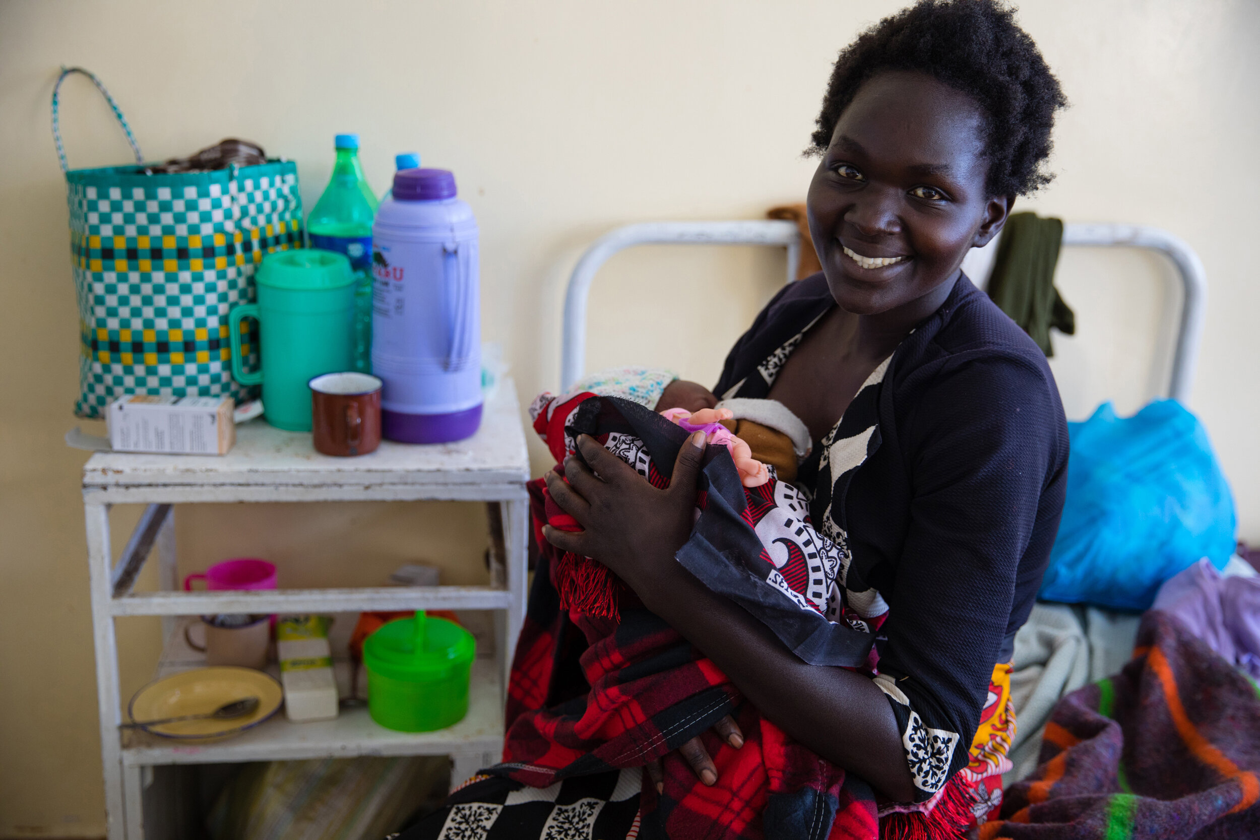 A happy Kenyan mother and her little one.