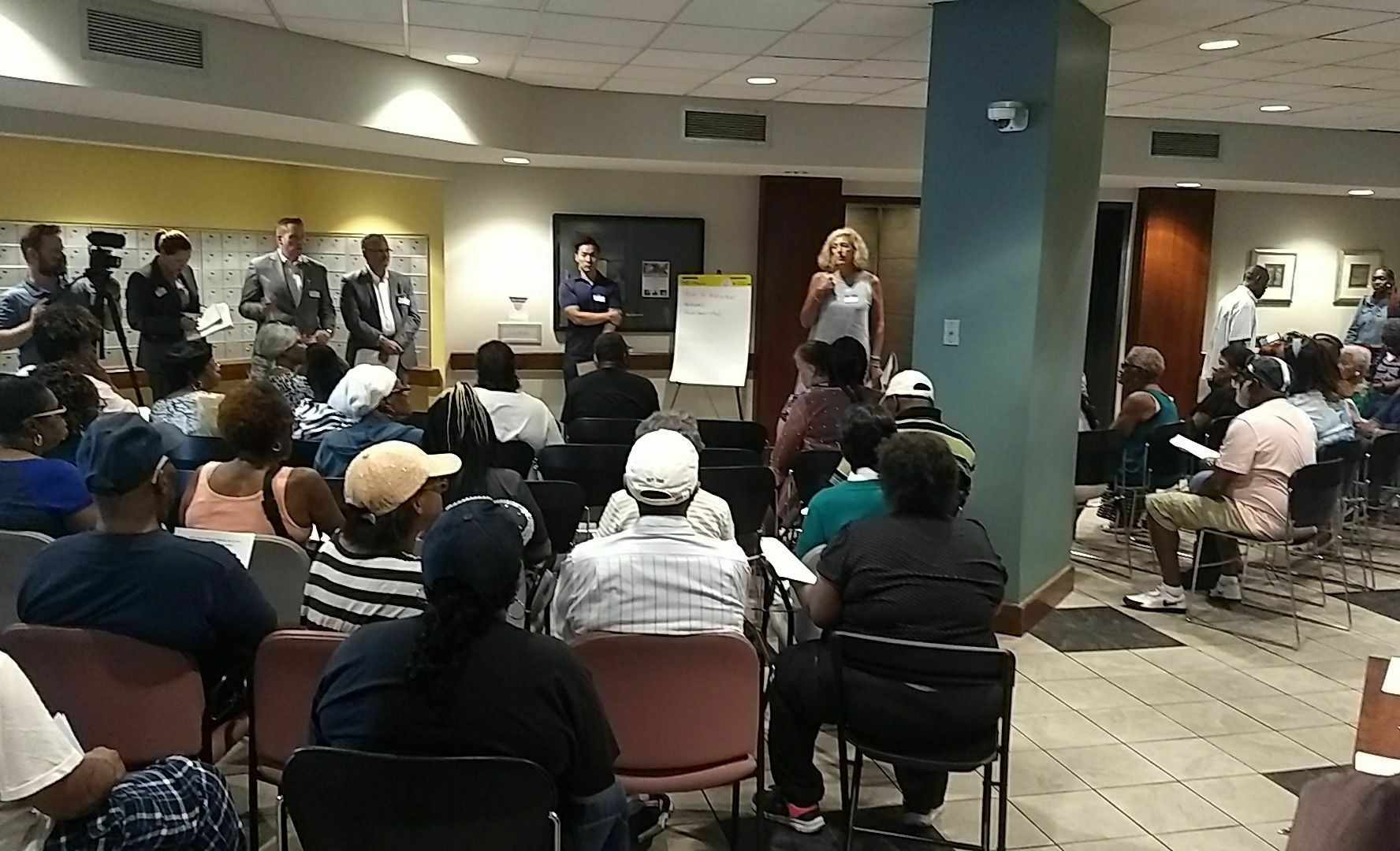 July 10, 2019 - Vicki Davis and other executives from Urban Atlantic and Edgewood Management field questions from tenants and supporters regarding slum conditions at the Bolton House building in Baltimore. Photo Credit: PSL-Baltimore.