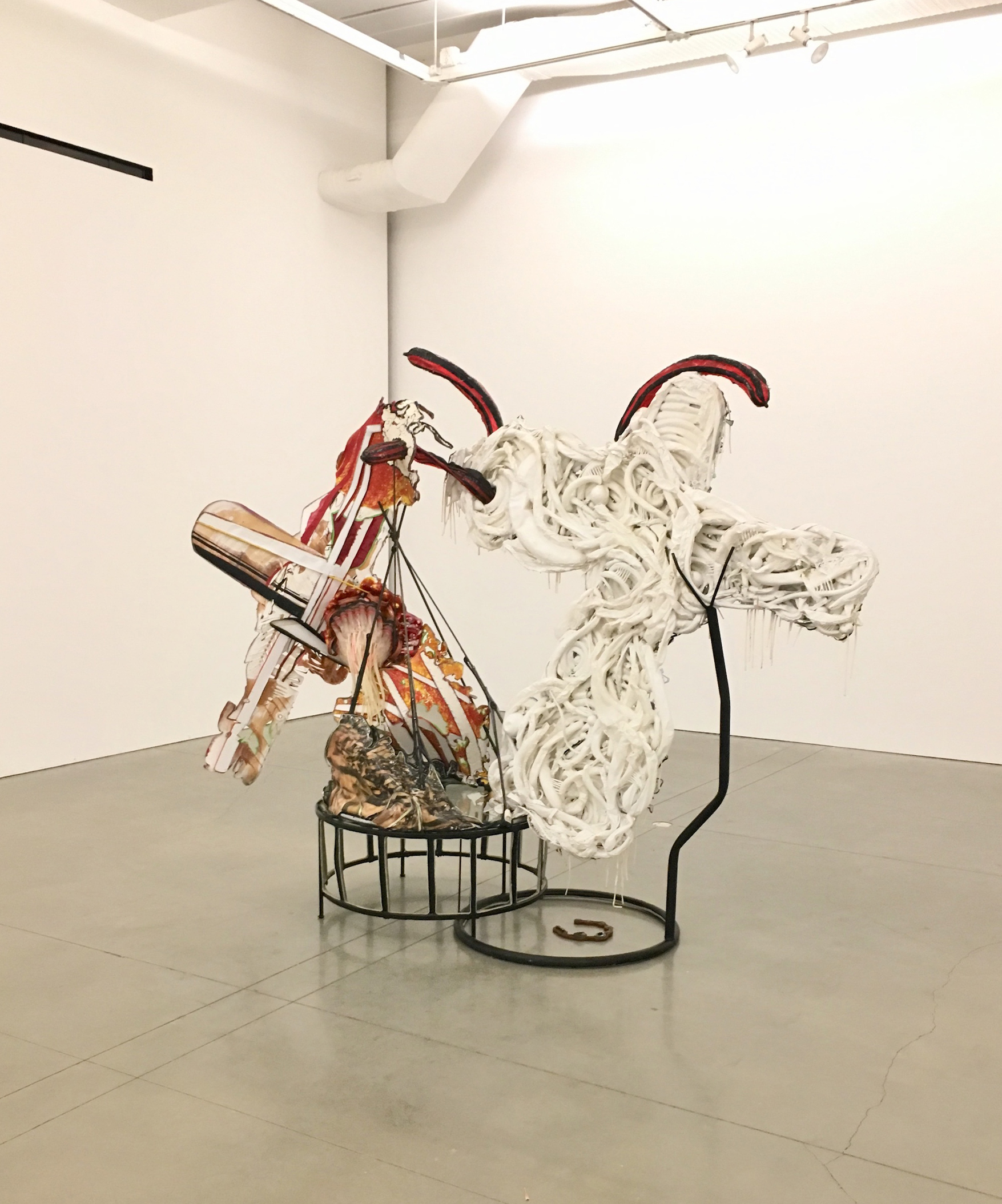 Alicia Piller  Monumental Loss  2018 Vinyl, latex balloons, leather, photos on paper, enamel, welded steel, fabric, plastic straws, glass, broken pipe 84h x 111w x 35d inches AP-008