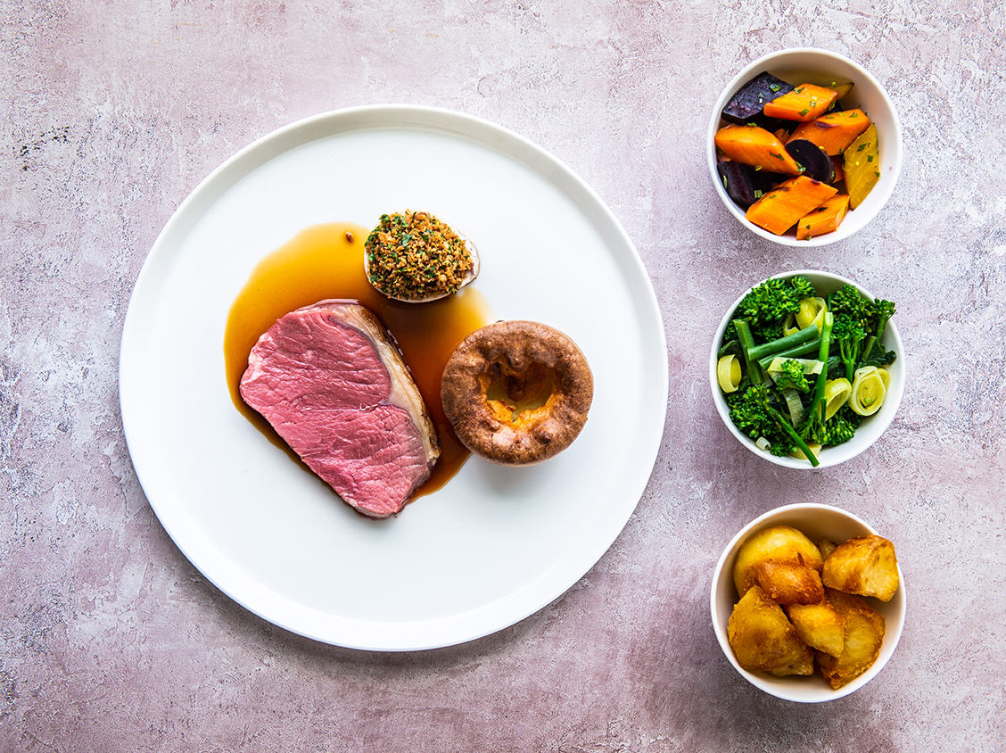 Salt aged sirloin of beef, roast bone marrow and Yorkshire pudding with selection of sides