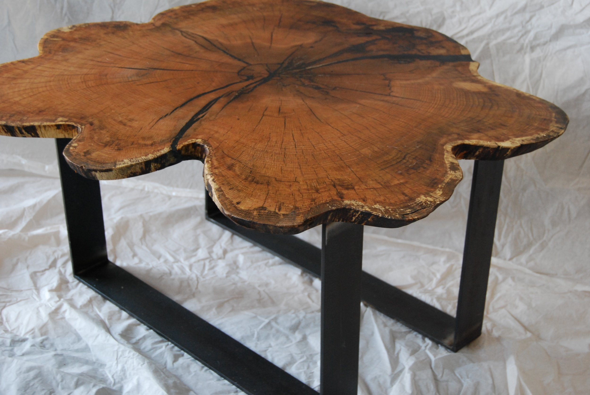 - oak round on black steel