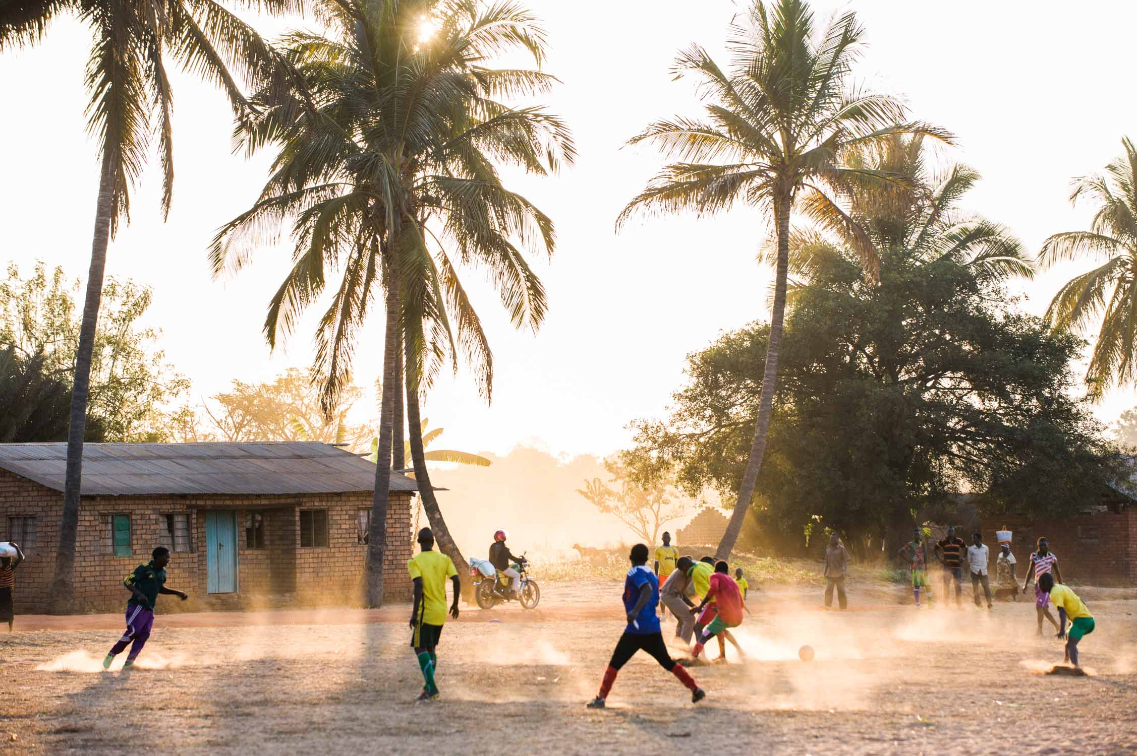 Sunset soccer match in Likuyu village.