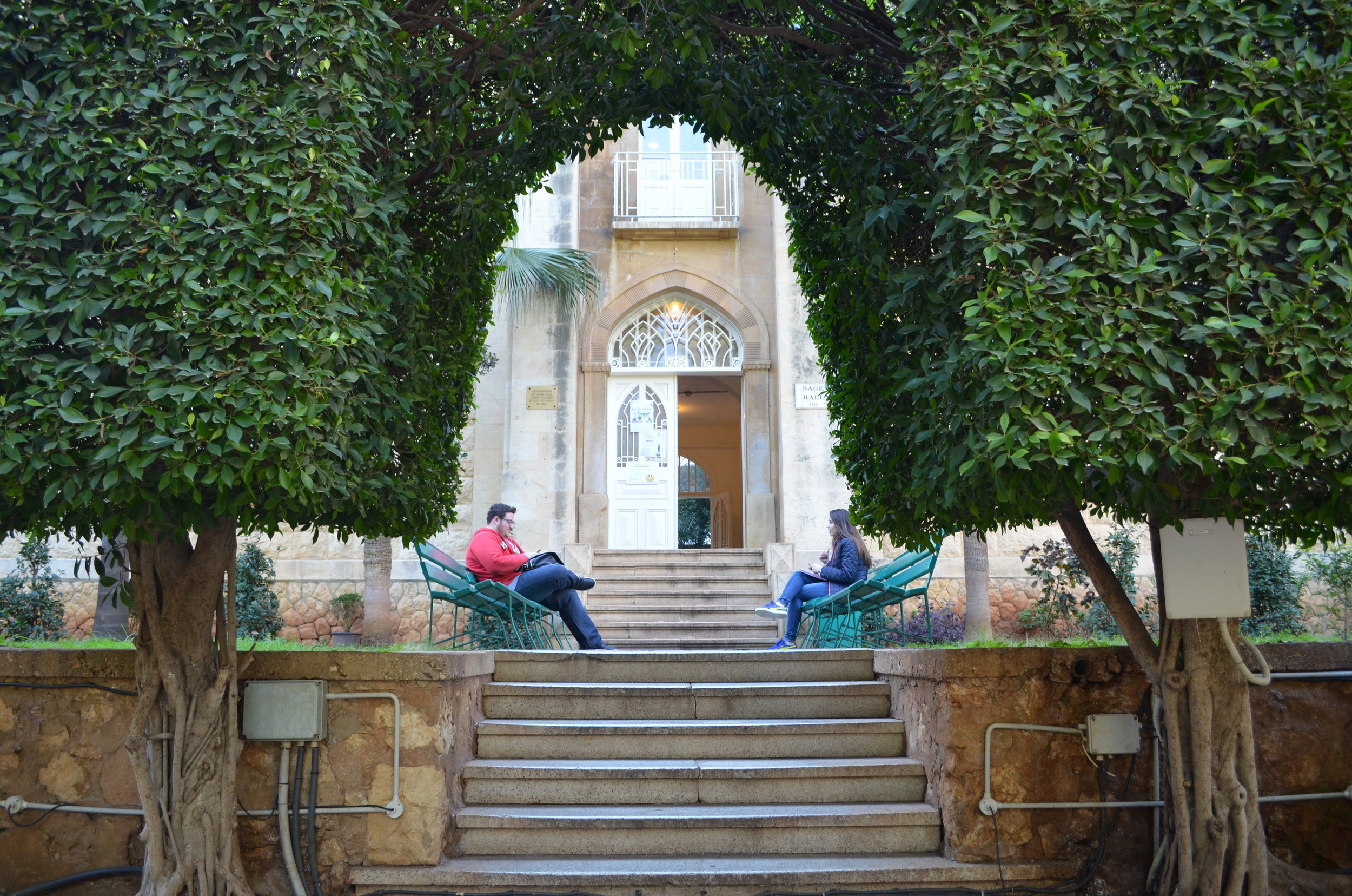 LAU students by the entrance of Sage Hall, Beirut campus.