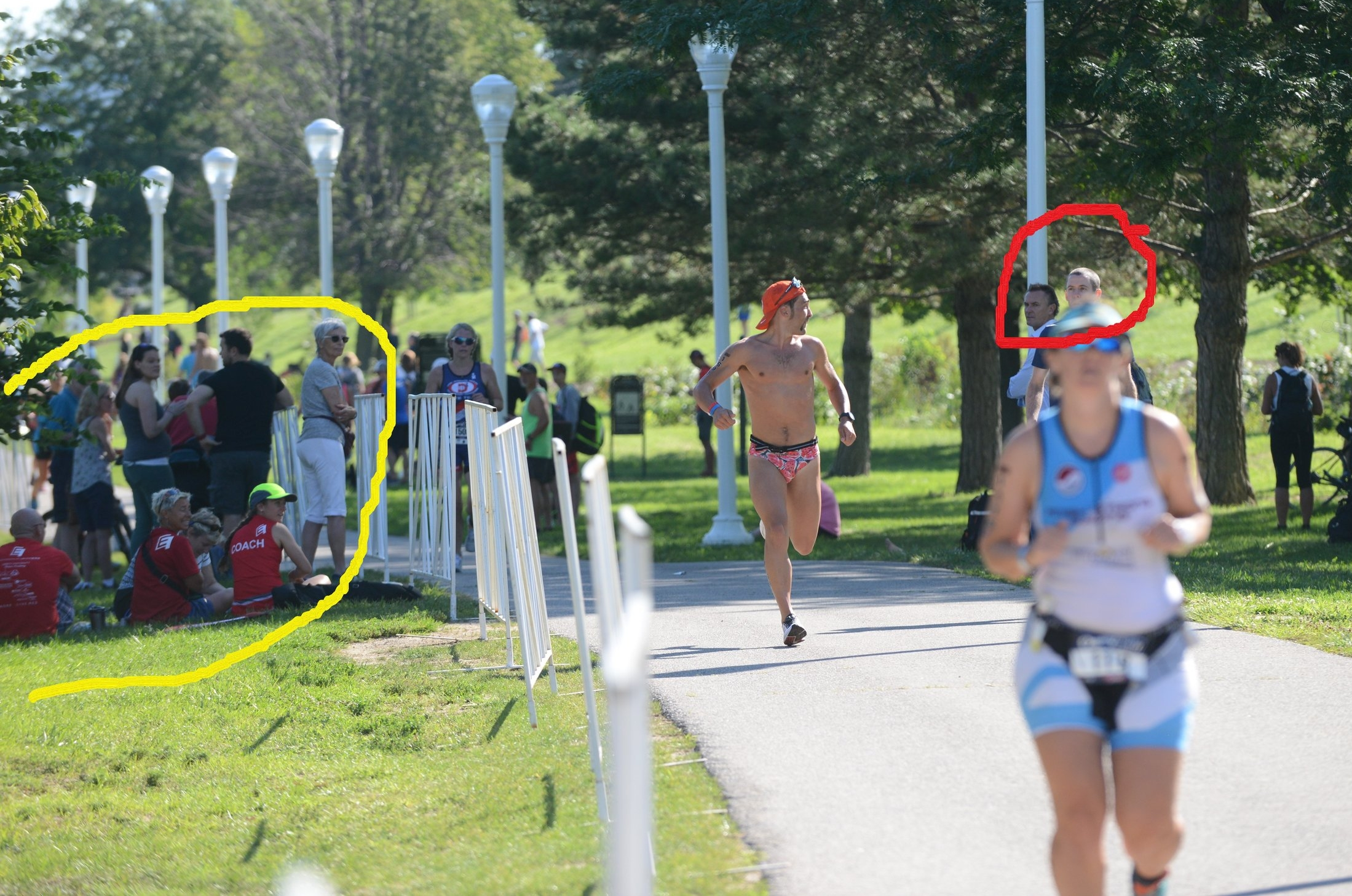 Arguably the best photo of the weekend. On the left (circled in yellow) you can see how the spectators in Cleveland couldn't keep their eyes off my nice firm buns and fruit filled speedo. On the right you see coach Jimmy telling me the life story of the kid in first place.