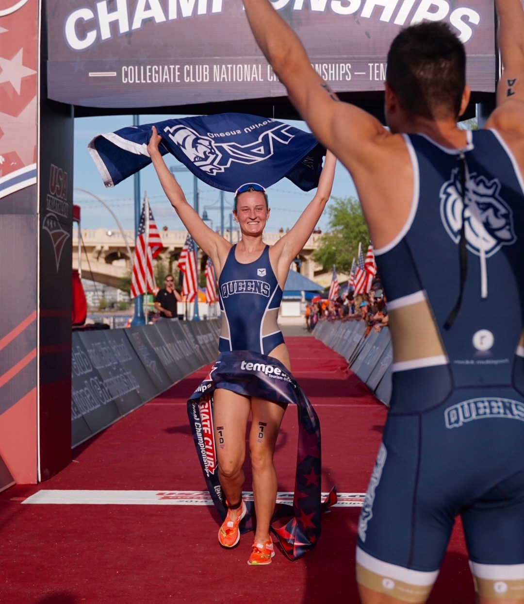 Anabel Knoll, Queens University, crossing the finish line first in the Mixed Team Relay (Photo: Full Send Triathlon)