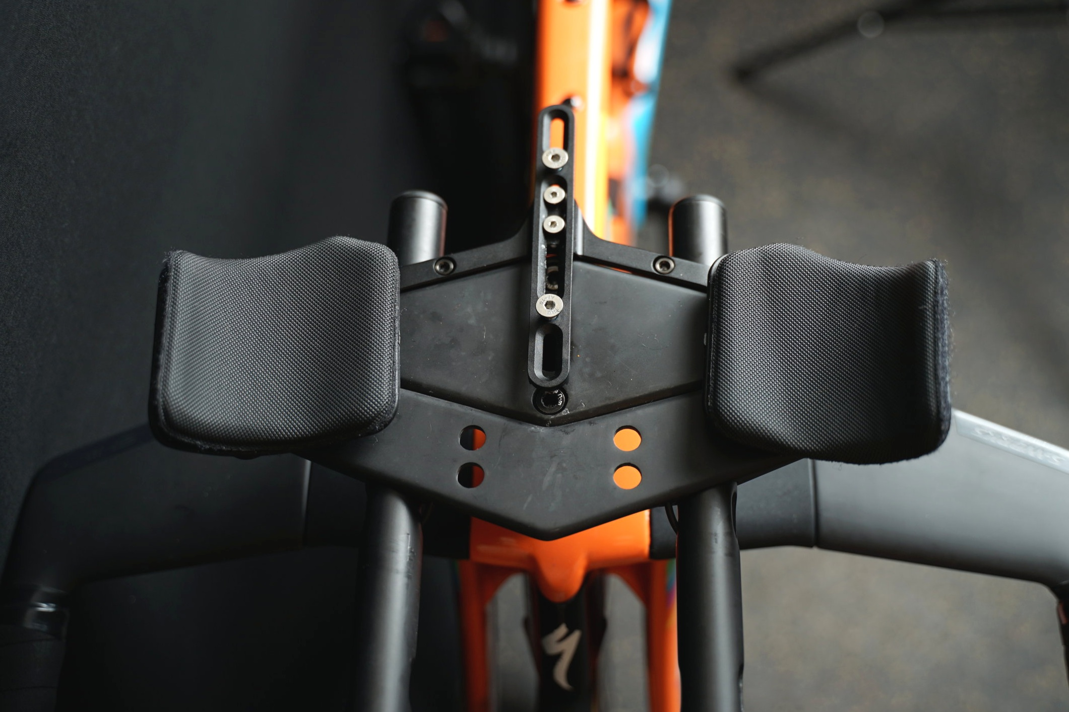 The water bottle cage holder can mount to either the front or the back of the wing, and then it has a sliding adjust-ability from there to position the bottle either closer or farther from you. Can also be used for a computer mount instead of a bottle cage.
