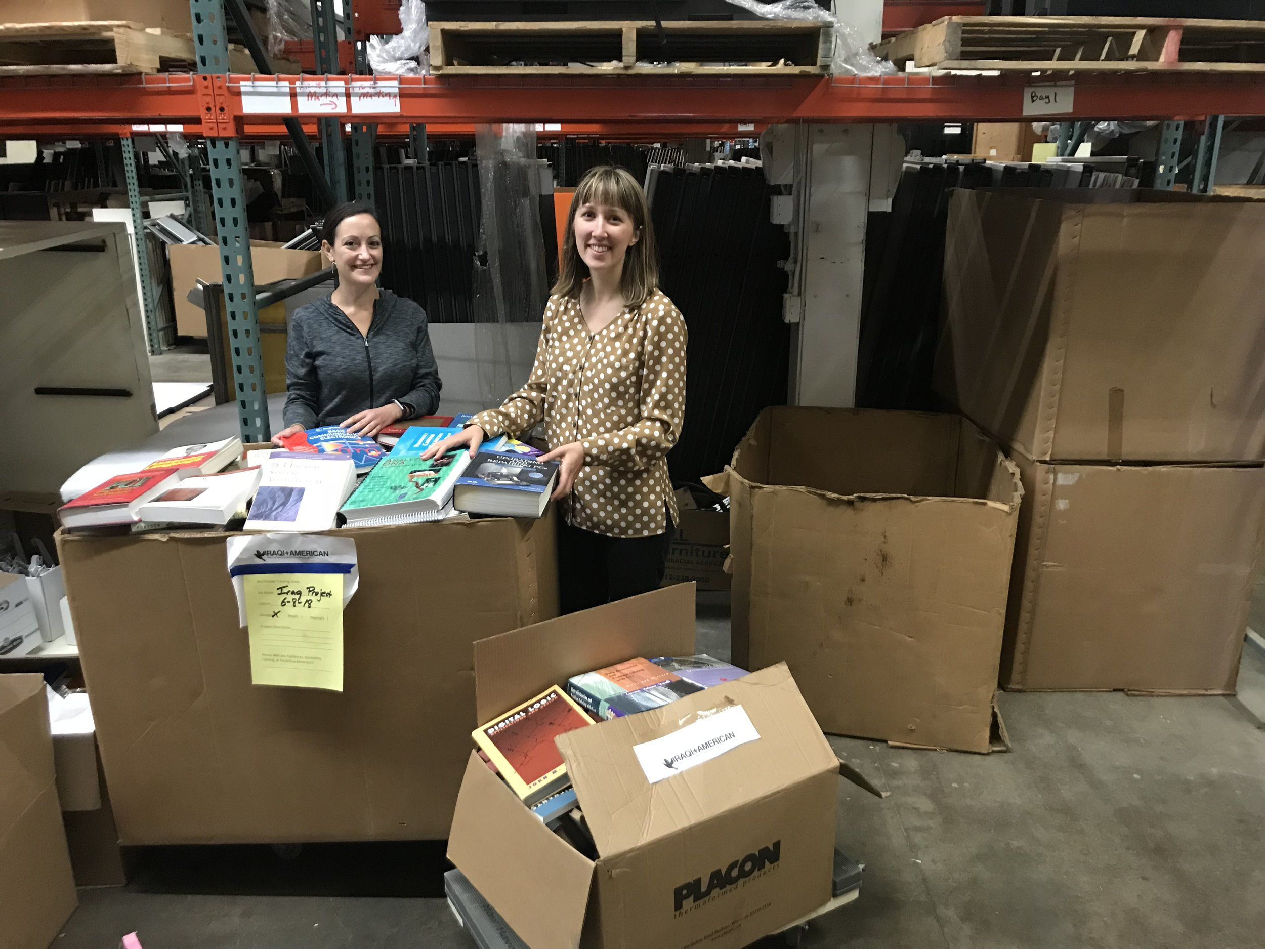 Jessy Belt and Erin Hart Organizing Books for Mosul
