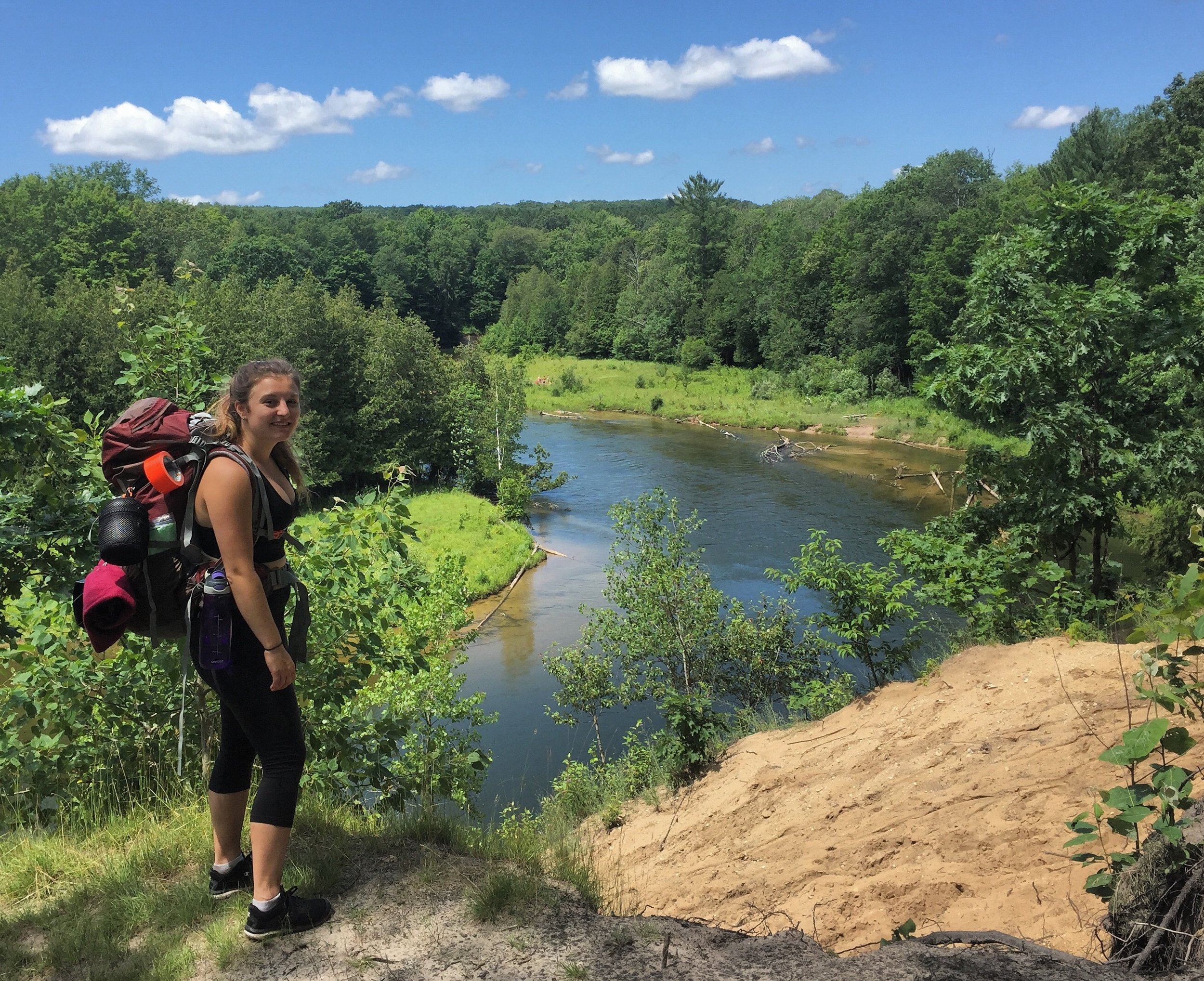 Lacie backpacking the Manistee River Trail in Michigan