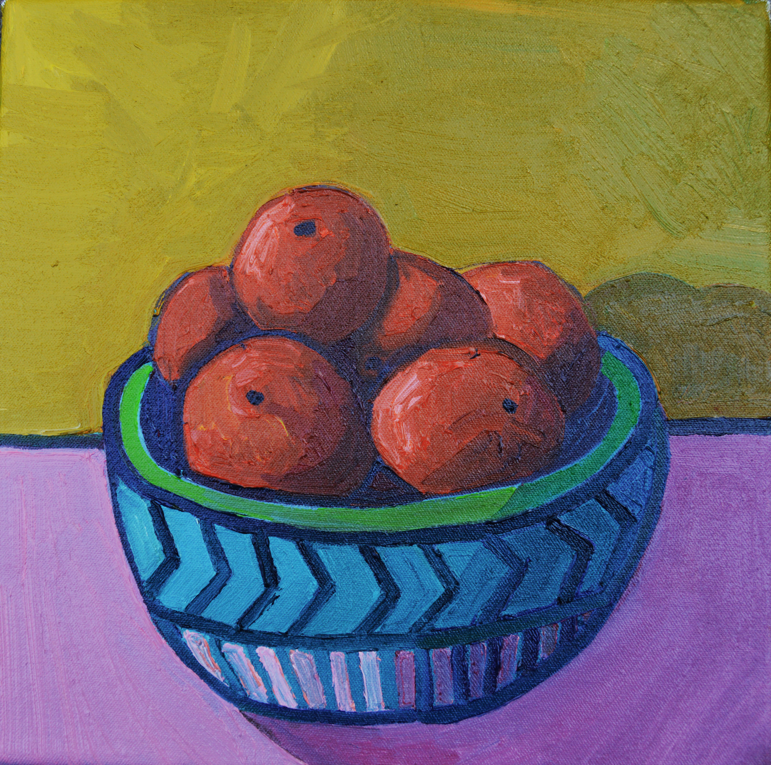 A bowl with six tangerines (possibly more)