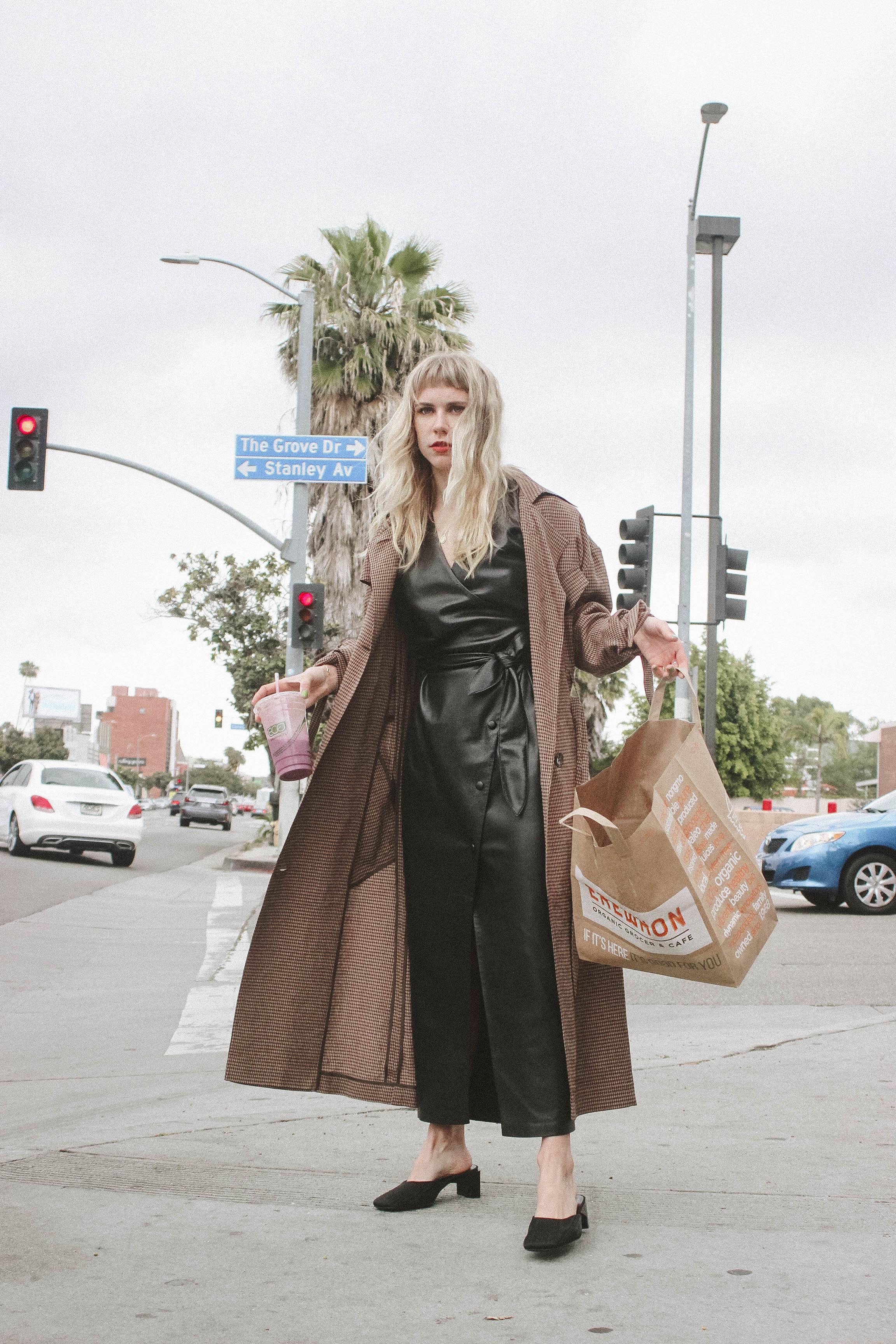 Penelope dress    €570  Noir coat    €520