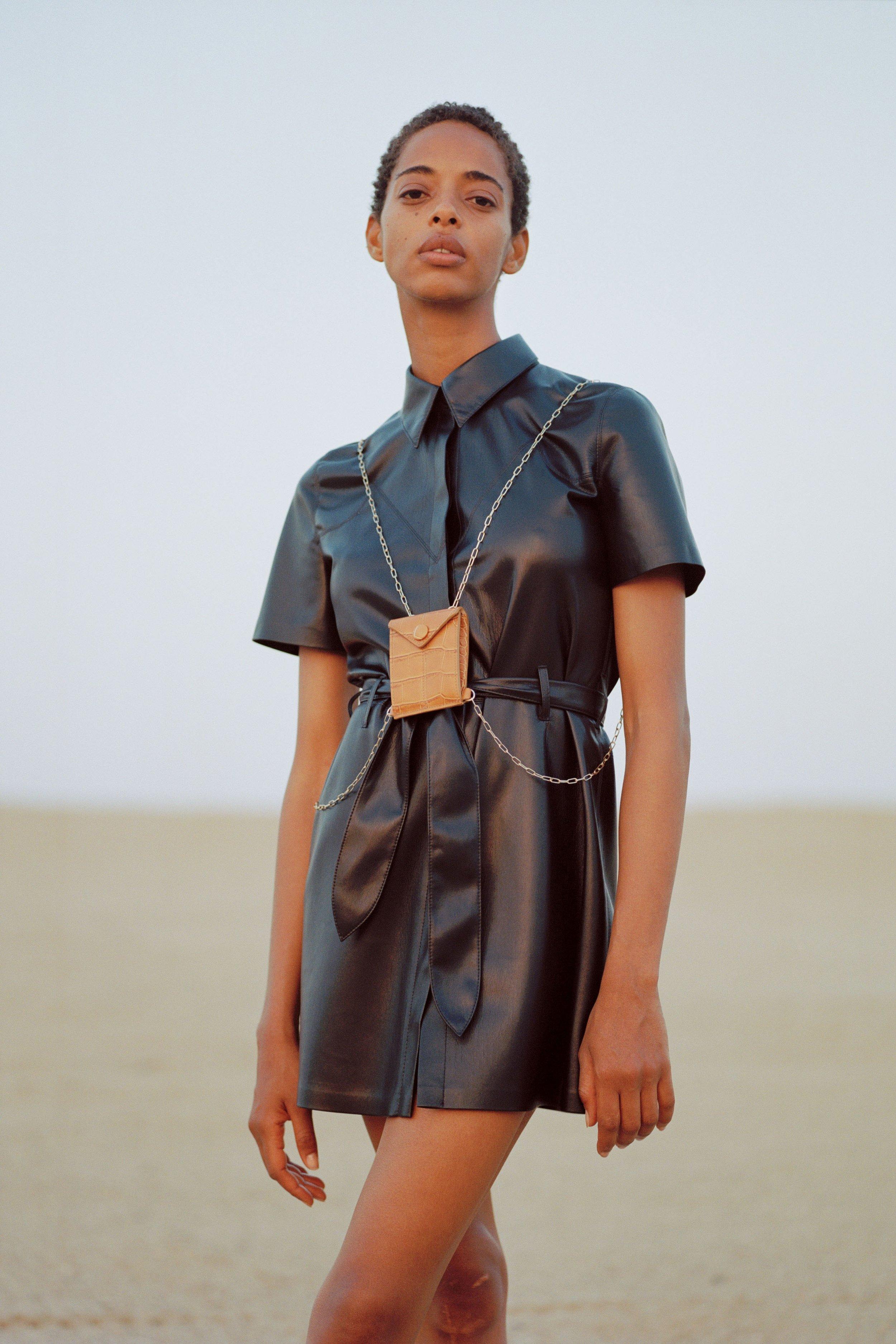 Roberta dress, black    €440  Mini Tove, tan    €250