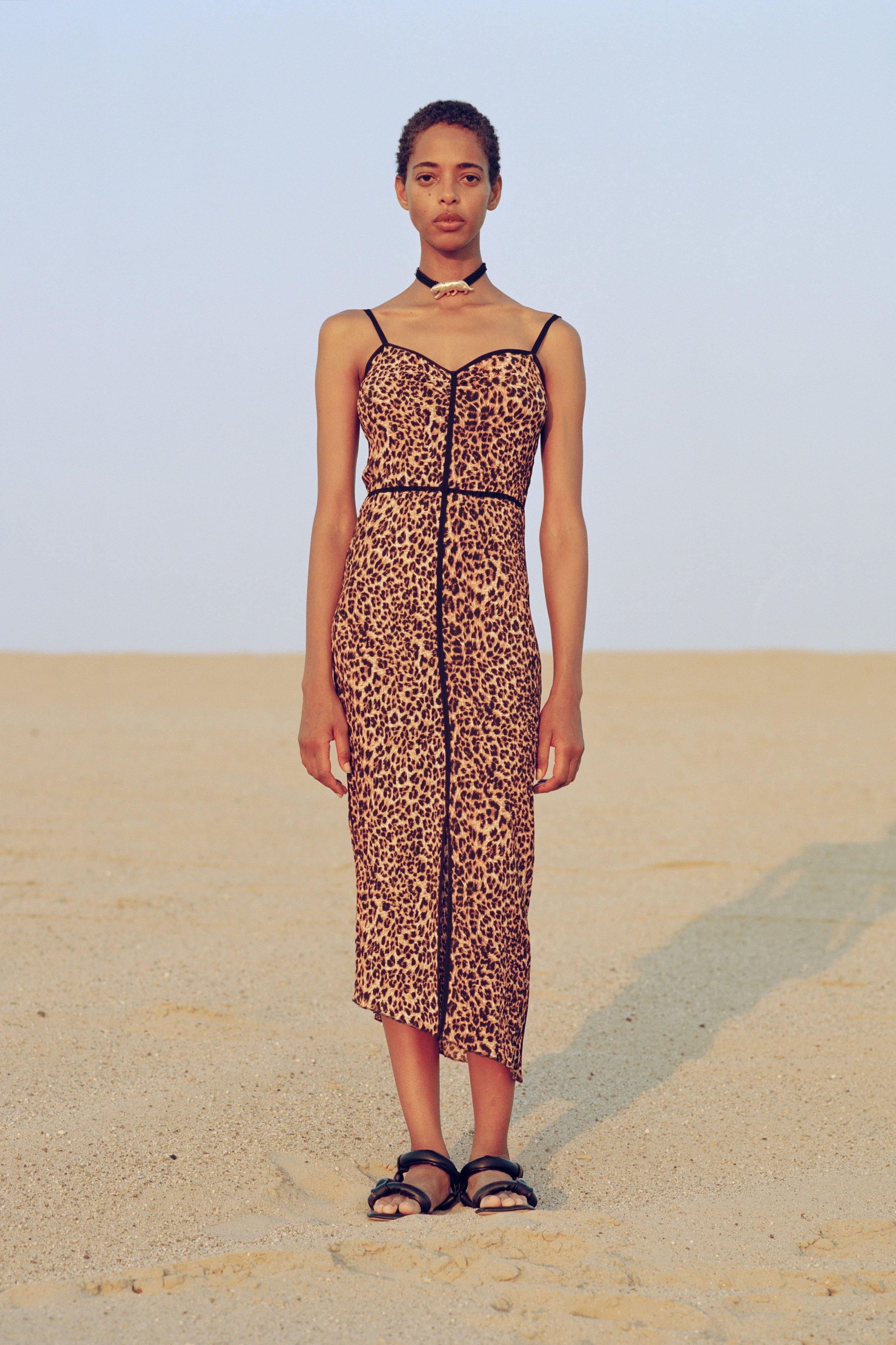 Abir dress, ocelot    €420  Yola sandals, black    €320