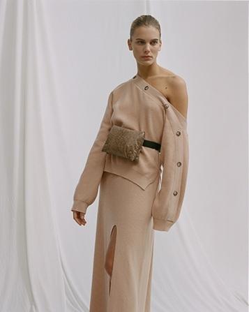 Camerin Off Shoulder Sweater  | €325  Paak A-Line Slit Skirt  | €295  Tao Puffer Belt Bag  | €360