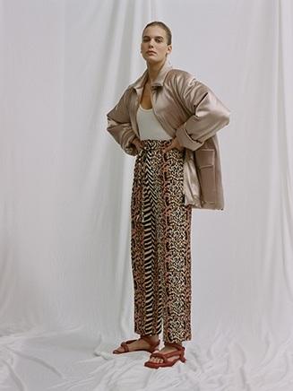 Sompa Satin Puffer  | €790  Maike Terry Knit Bodysuit  | €230