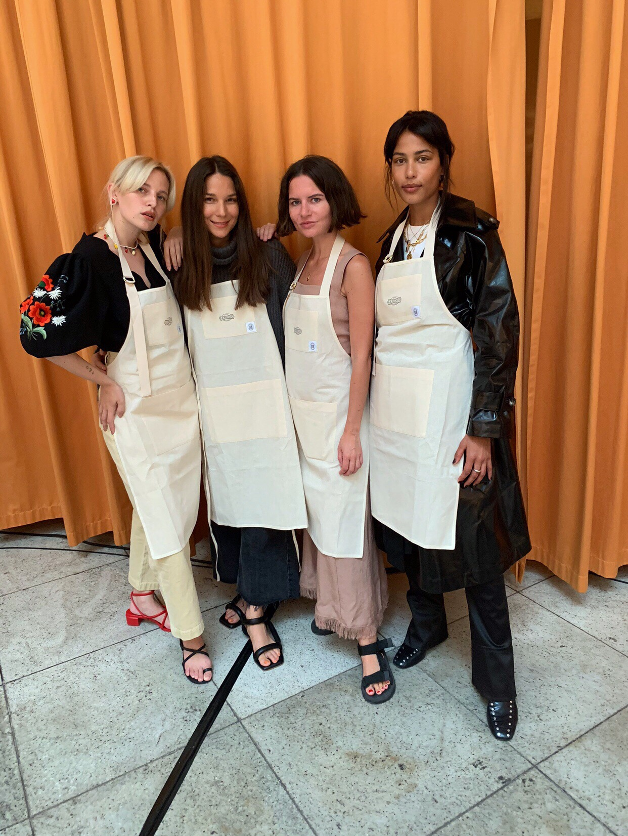 Marfa Creme Wide Leg Jeans | €290   Yola Puffed Sandals | €32 0  Moun Western Strap Dress | €580   Ambar Vinyl Trench Coat | €870