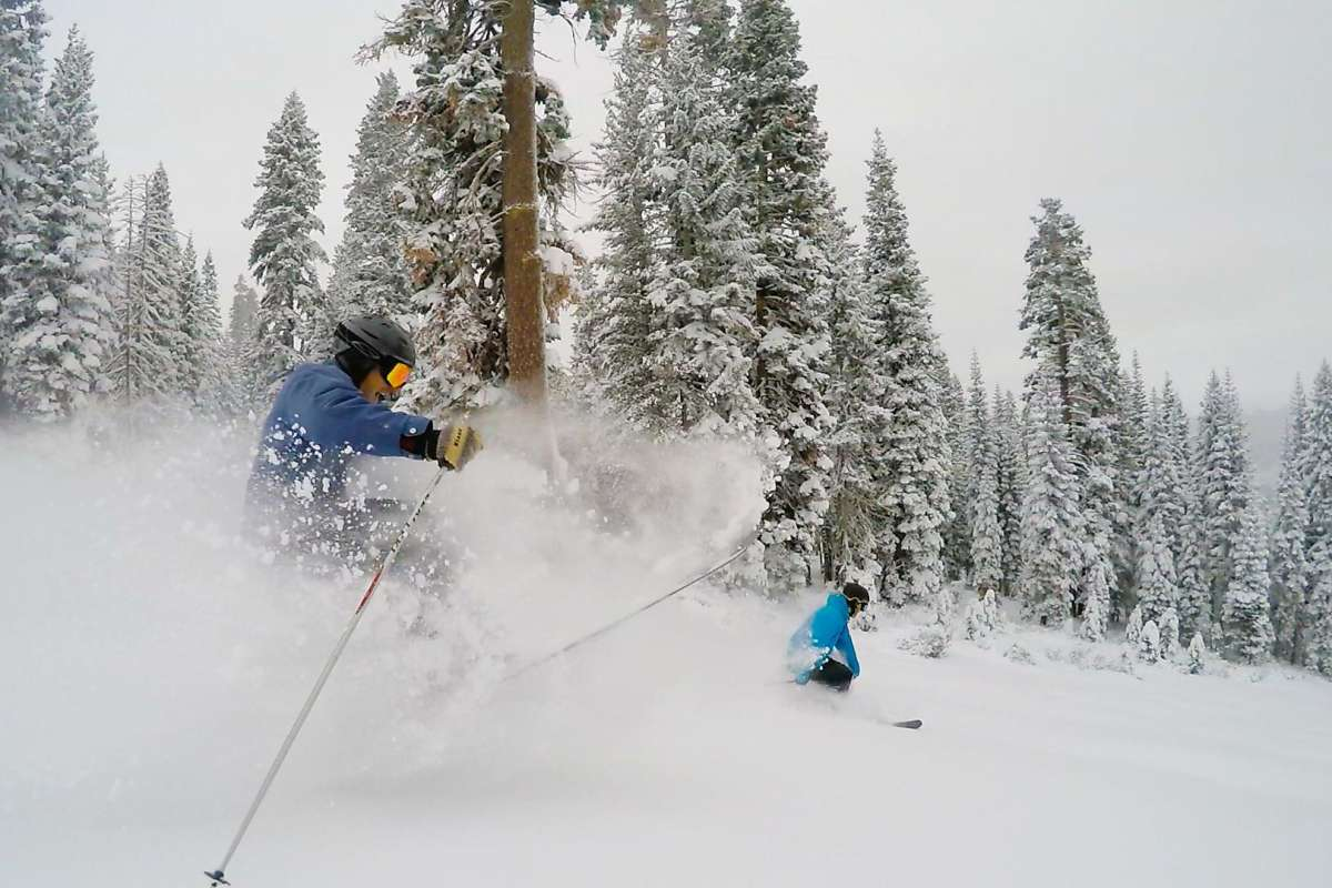 Skiers enjoy the plentiful snow at the Northstar at Tahoe resort, which reported a 28-inch base after early December storms. It is one of the Vail resorts and offers discounts for buying lift tickets in advance.