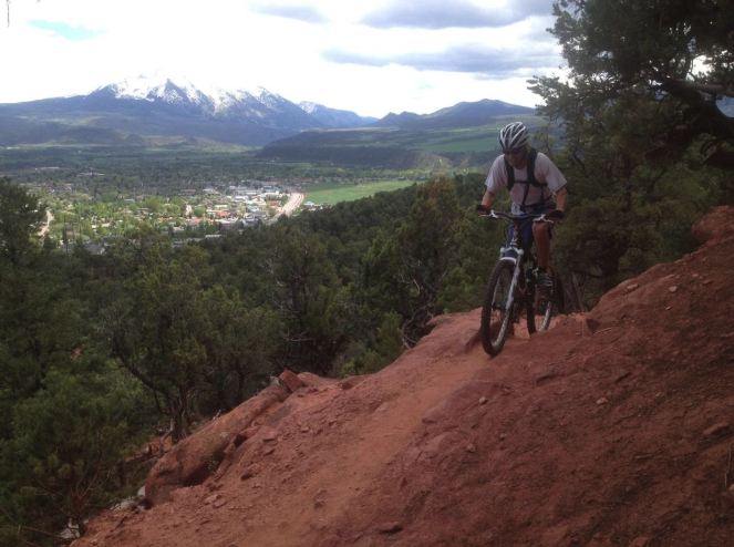 A mountain biker on Red Hill, near carbondale. The special recreation management area, though mostly BLM land, is accessed via a parcel controlled by the Aspen Valley Land Trust.   Aspen Daily New file photo