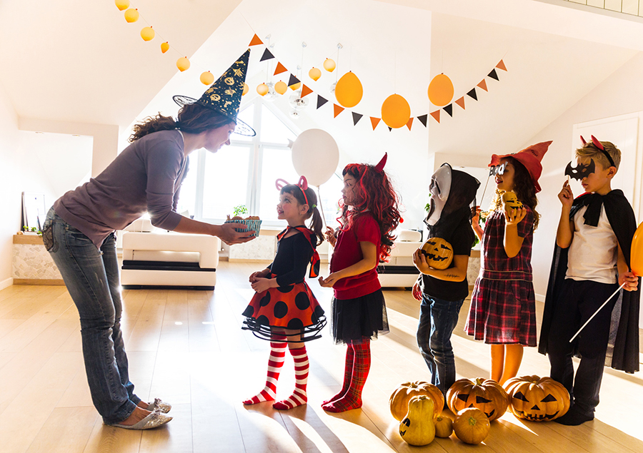 halloween-mom-giving-out-treats.jpg