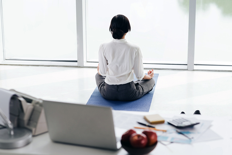 meditating - workplace wellness.jpg