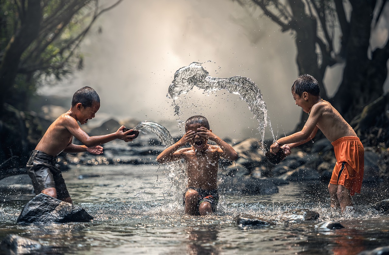 3 children playing river.jpg