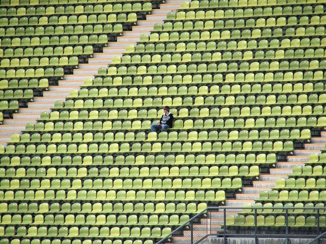 lonely person sitting stadium alone.jpg