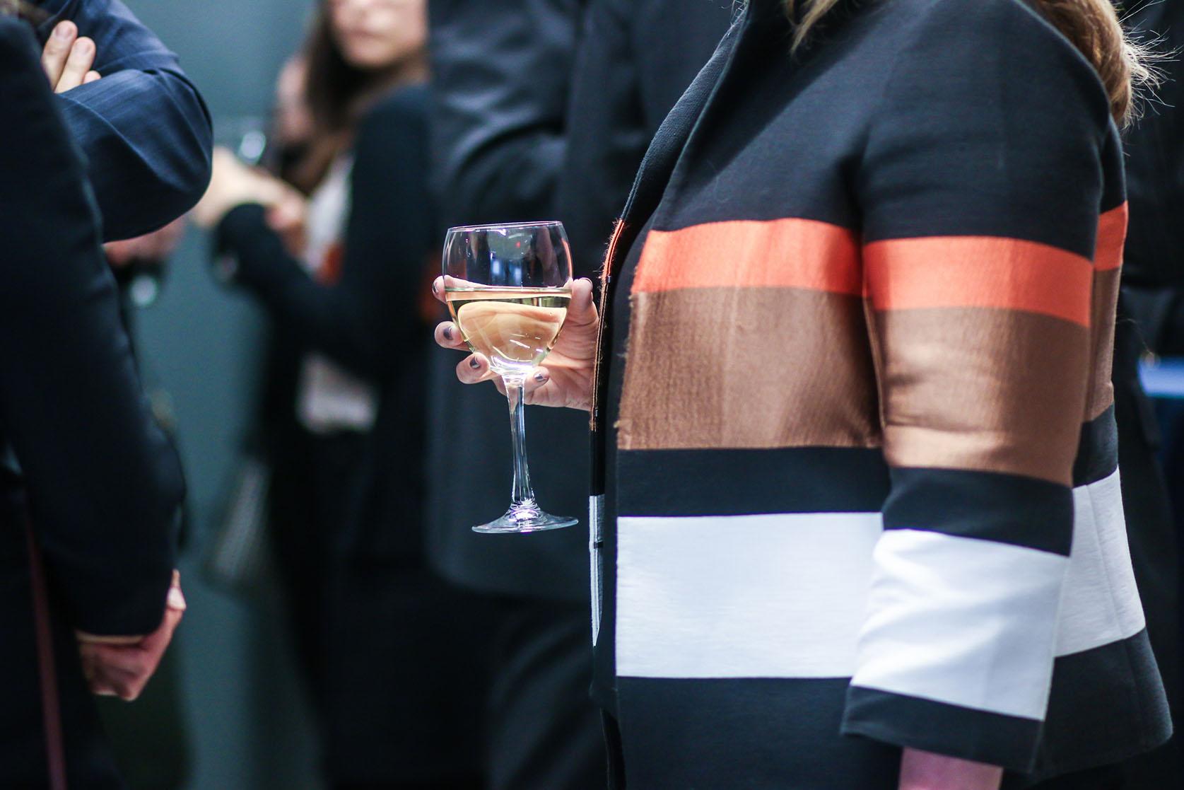 woman alone networking event wine.jpg