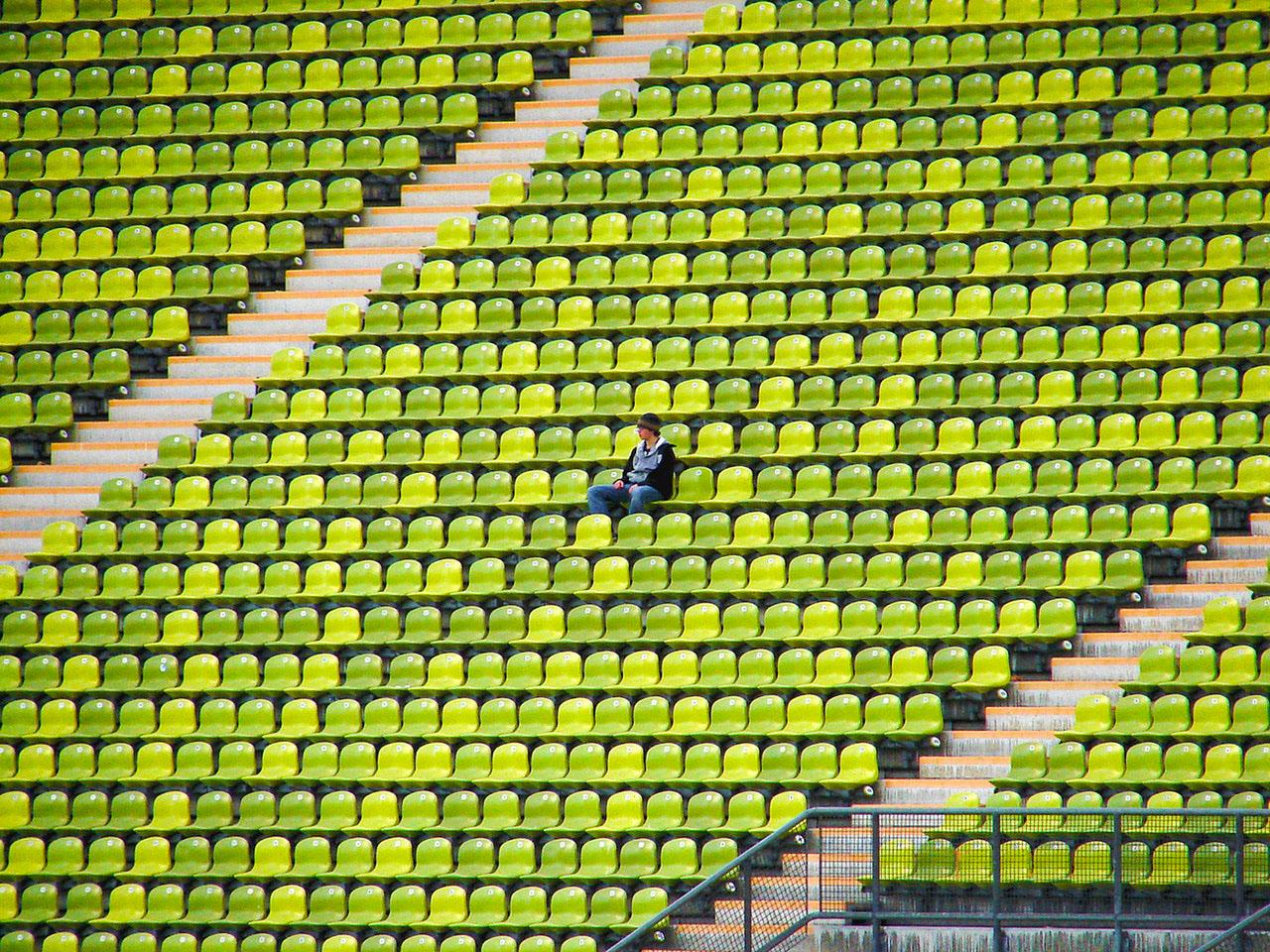 single person sitting in stadium alone.jpg